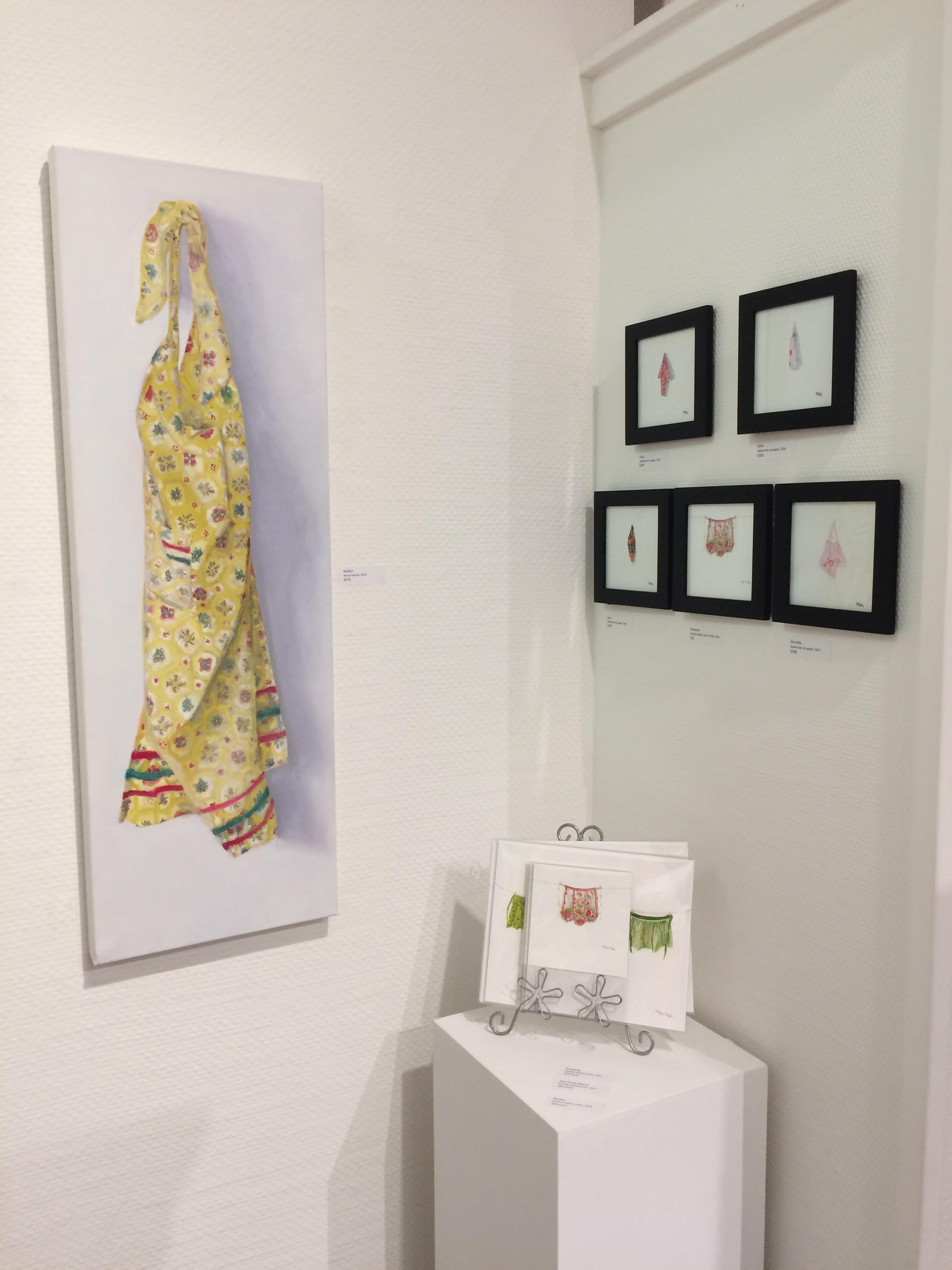 """Photo by Marissa Solini. Featured """"Kaitlyn"""" paintings and assorted apron mini paintings and prints"""