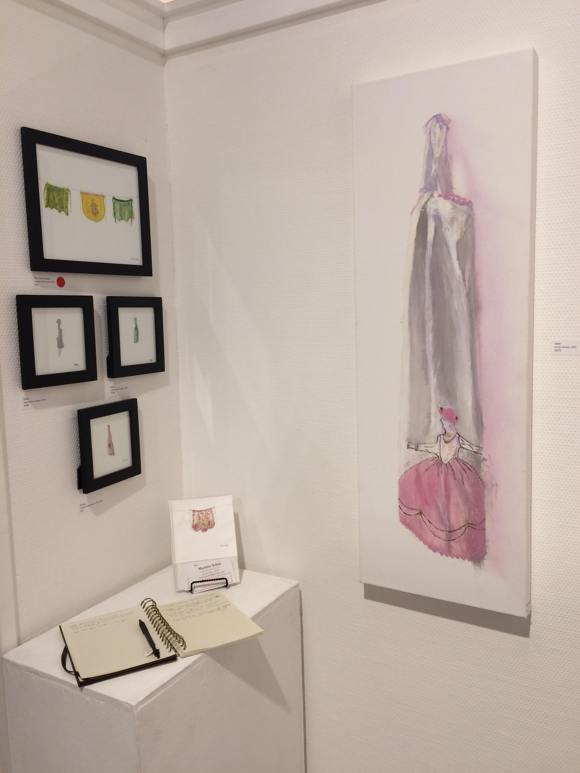 """Photo by Marissa Solini. Featured """"Jane"""" paintings and assorted apron mini paintings and prints"""