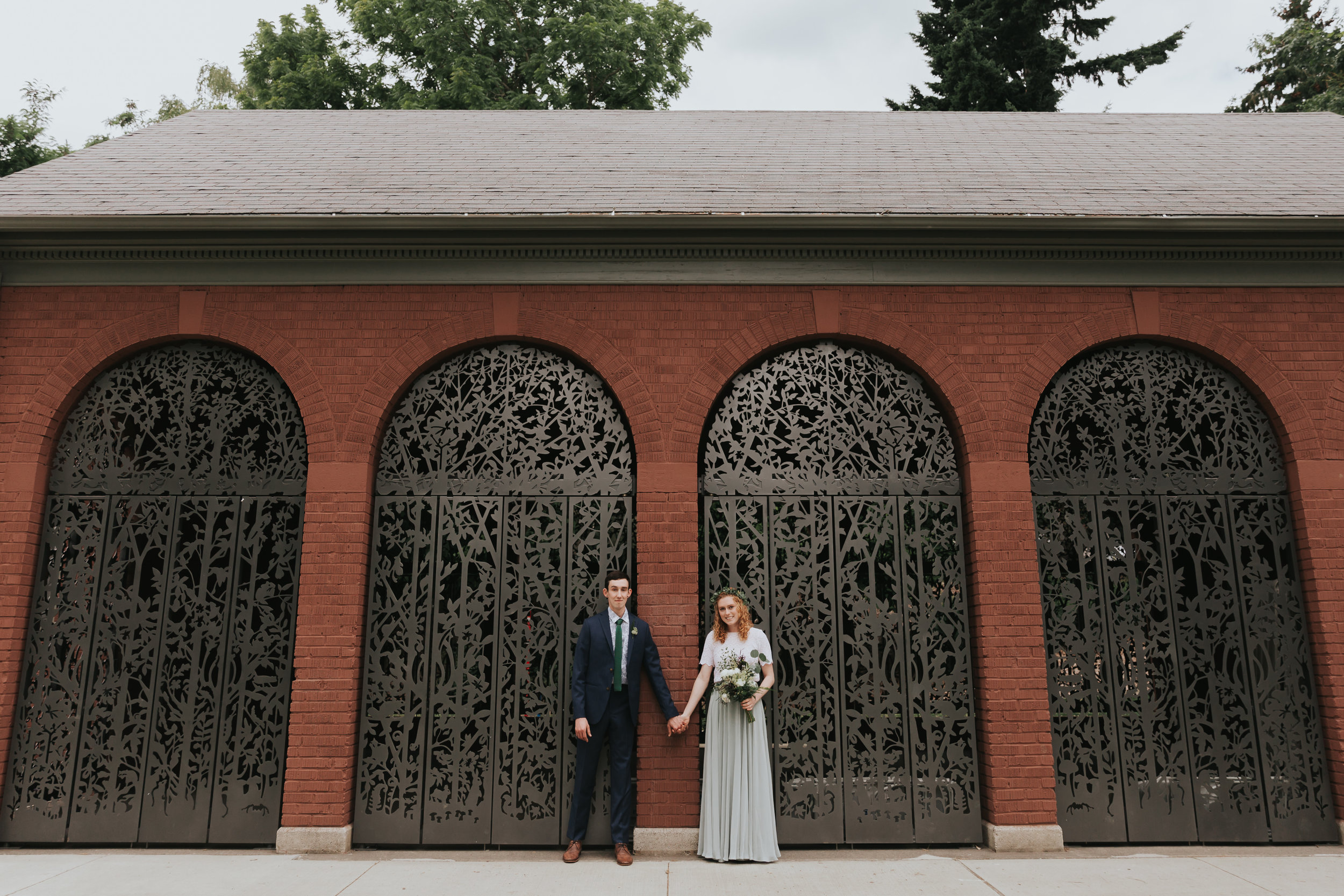 Ragan & Max in front of the Colonel Summers Park gates that Max designed!