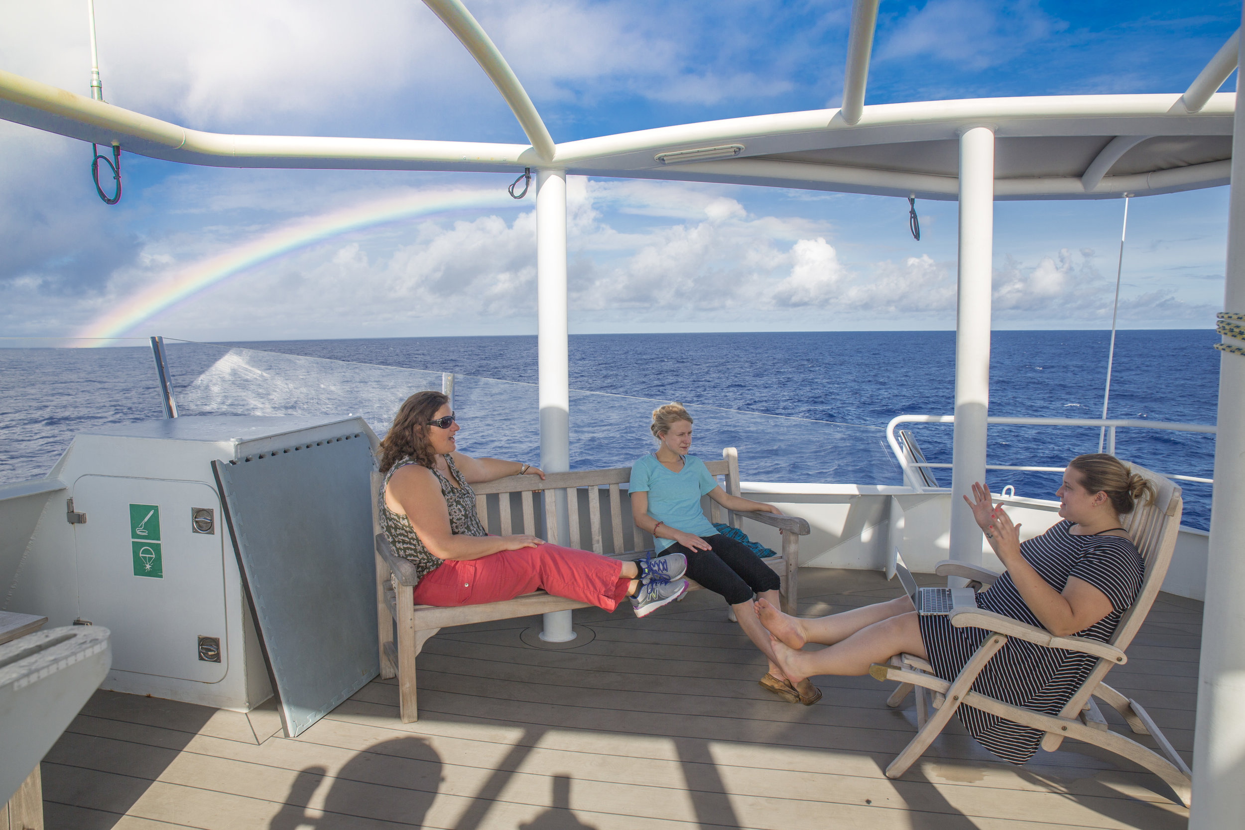 Discussing coral mucus aboard the R/V Falkor with Randi Rotjan and Anna Gauthier