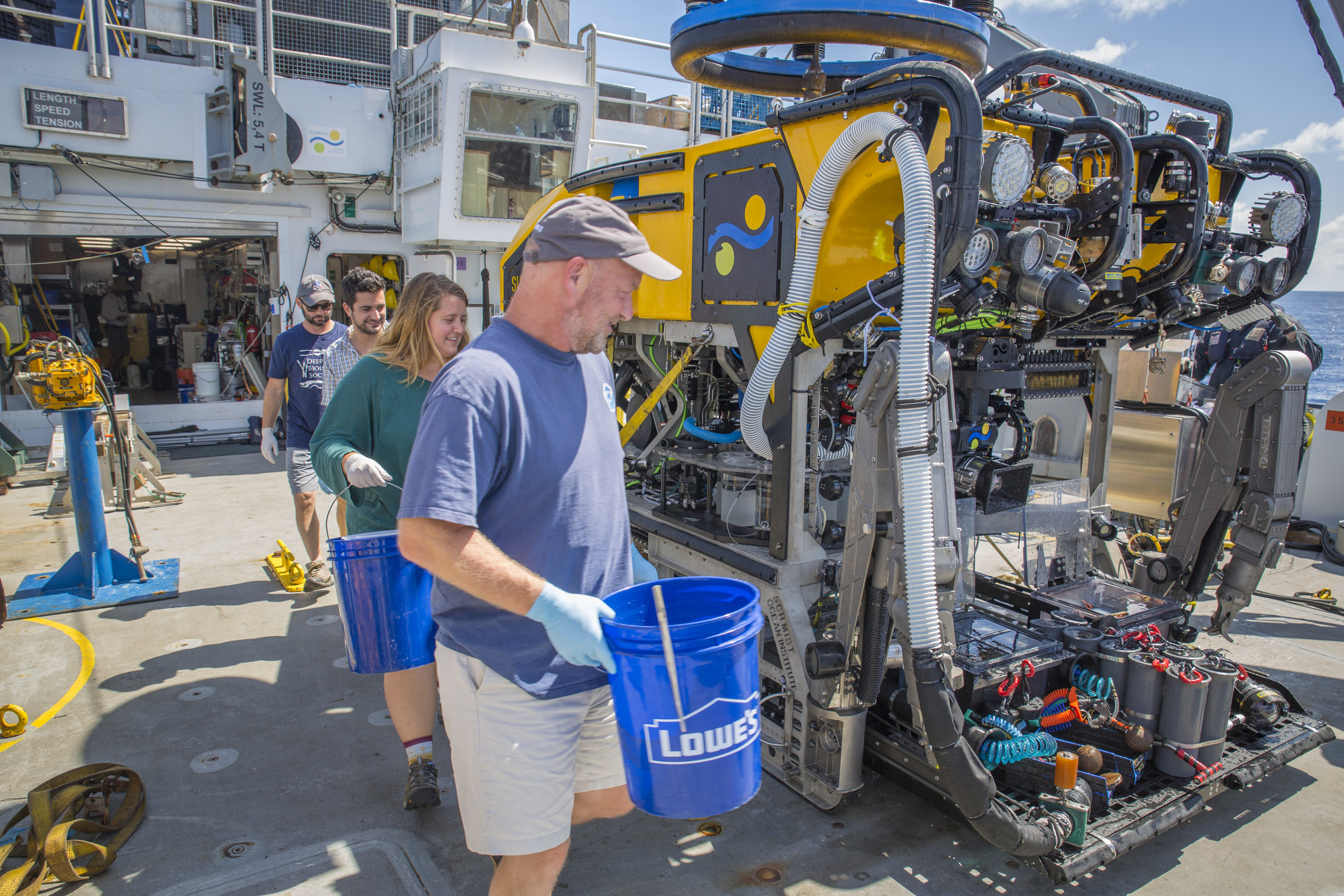 The science team marches out to retrieve samples after a successful dive