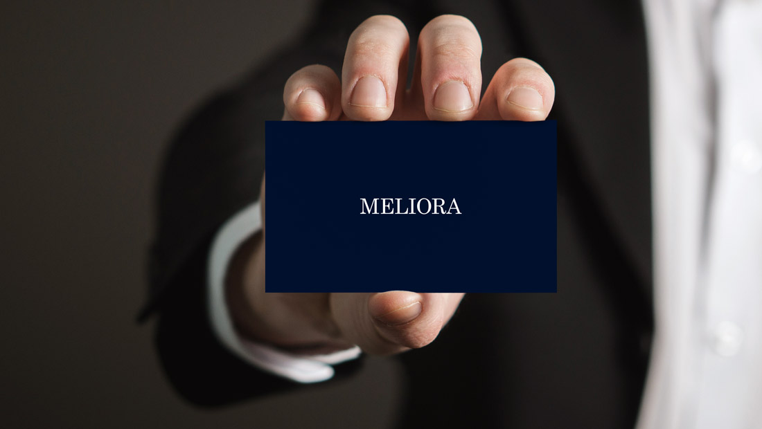 The University of Rochester's Latin motto meliora is removed from the logo to be given prominence on the back of a business card concept from creative marketing agency Insomniac Studios.