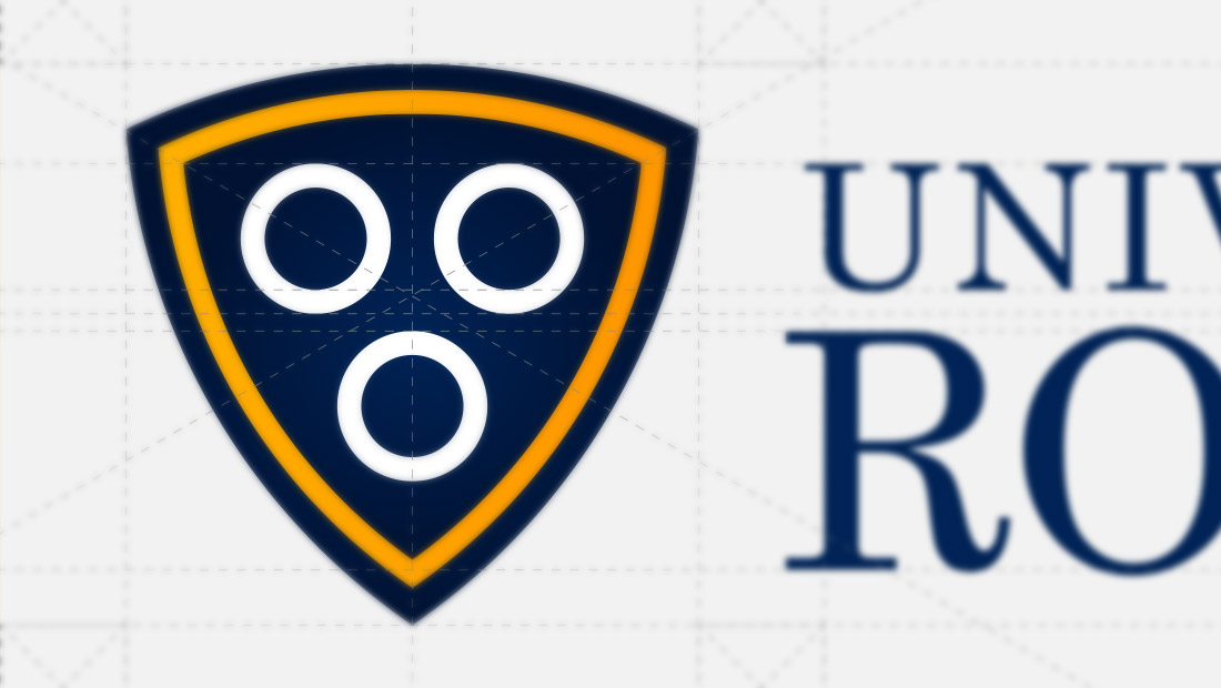 A closer examination of the University of Rochester's revised logo concept by graphic design and marketing services company Insomniac Studios.