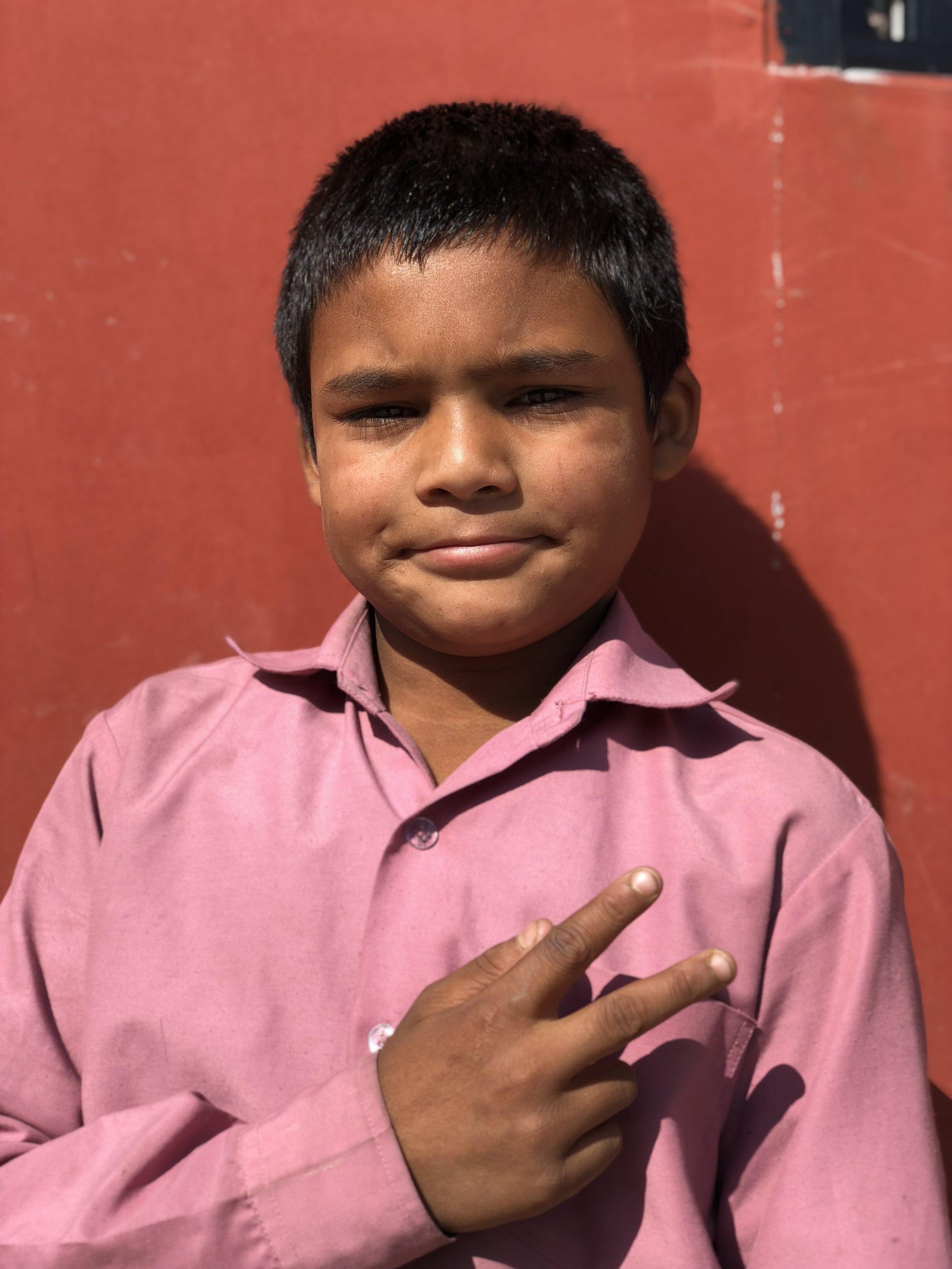 Arjun  Age 12  He likes to play football