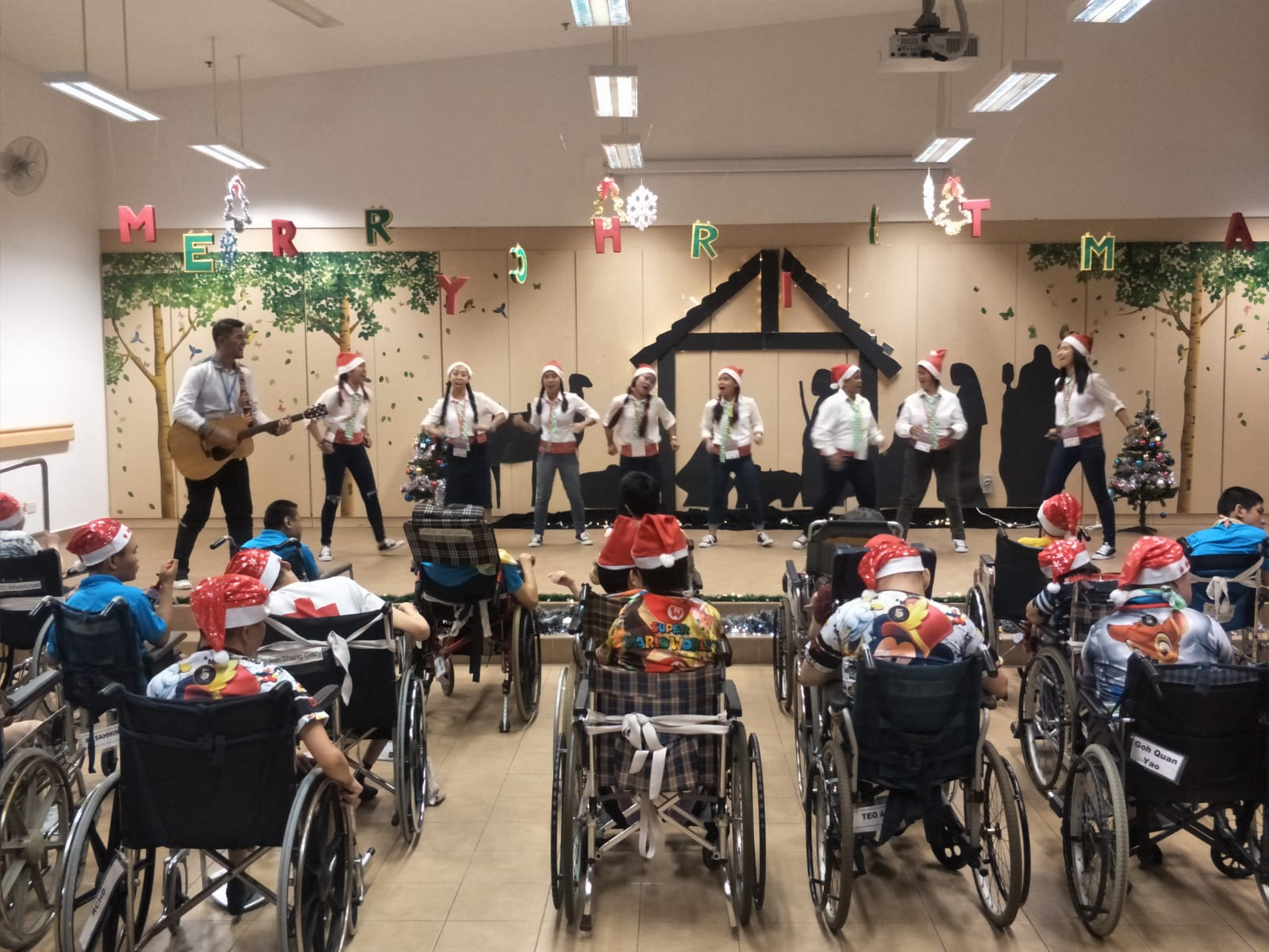 Our enthusiastic HOME Christmas Carollers at work!
