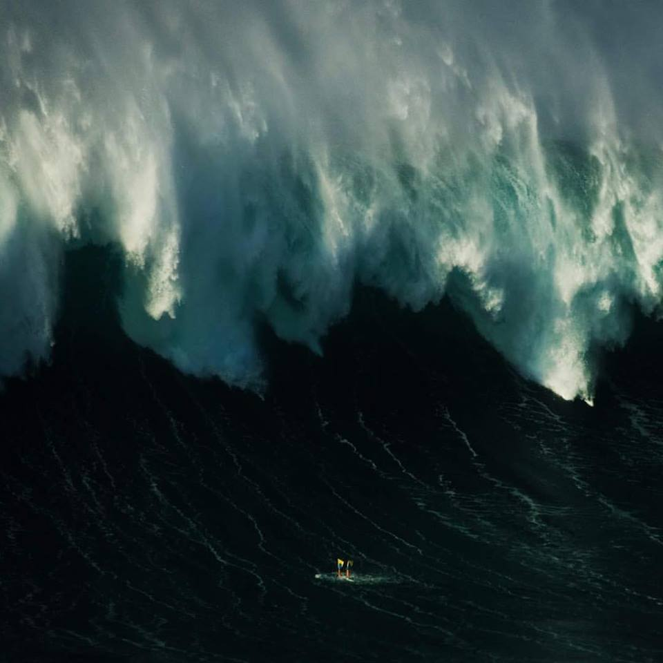 "Kalani dives under an avalanche of water  Photo: Joao ""Brek"" Bracourt"
