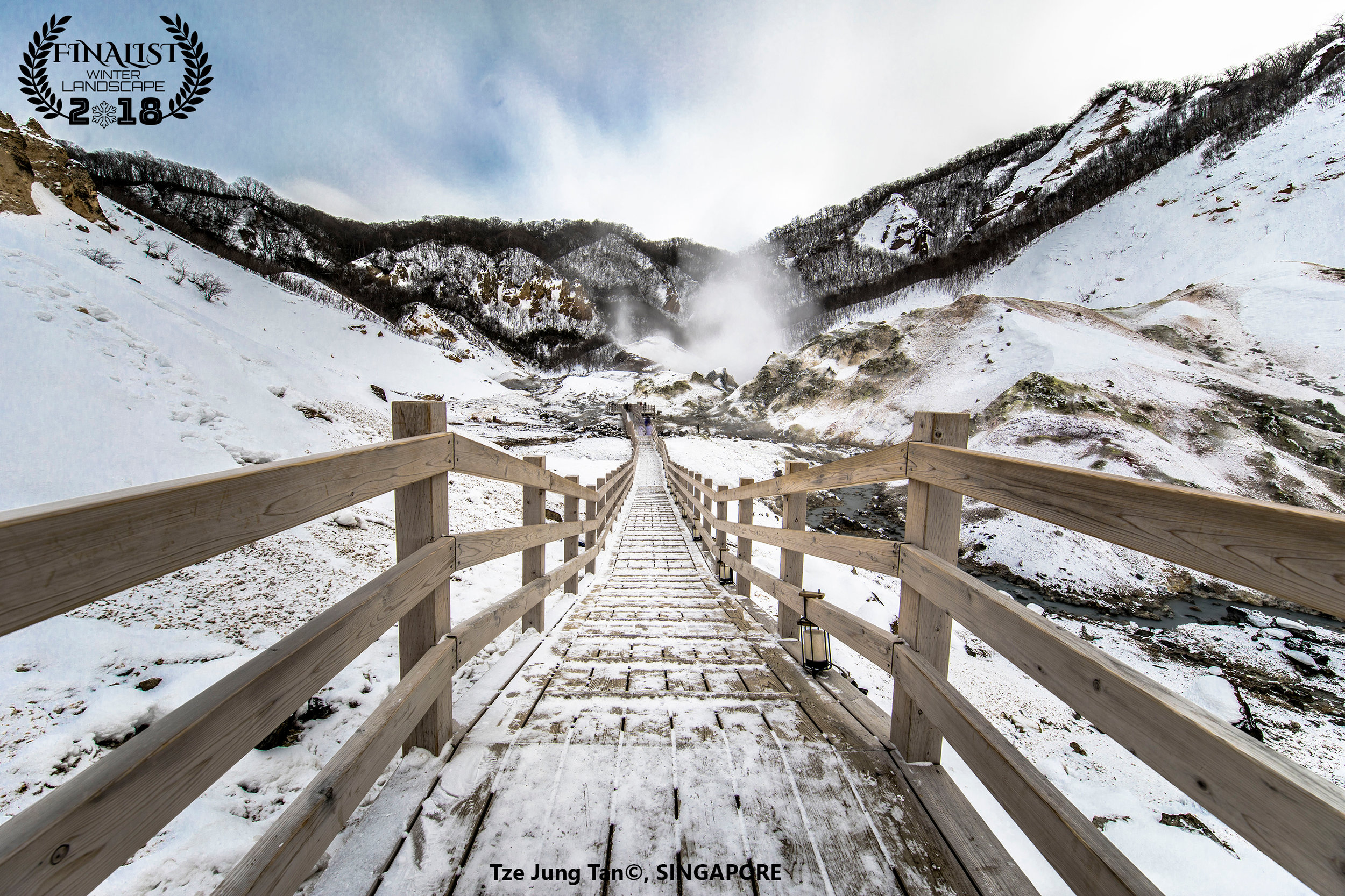 """Noboribetsu, Hokkaido:  'A trip to Hell Valley'   """"Amidst the snowy, frigid landscape rises Hell Valley, a geothermal crater formed from a volcanic eruption 20,000 years ago. It evokes scenes of what hell might look like with its boiling sulfuric hot springs and volcanic steam plumes.""""  Photographer: Tze Jung Tan, SINGAPORE"""