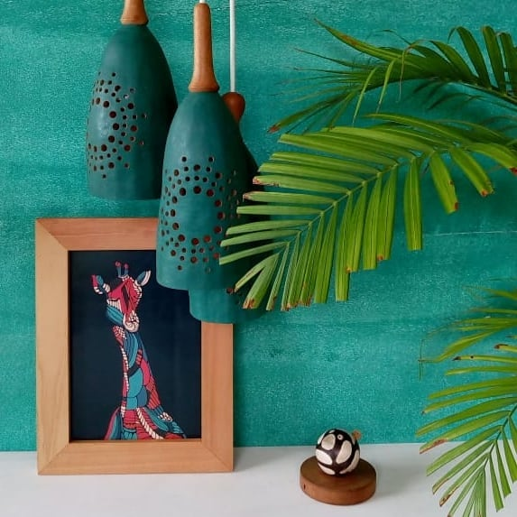 😍Love love this image by @seedlingkenya featuring our blue giraffe print. . @seedlingkenya make sustainable home decor, lighting fixtures and more from baobab seeds, really beautiful stuff - check them out ✨💡🍃 . We have prints available in various sizes, plain or framed - get in touch for more details if you're interested 🖼️💙
