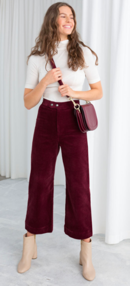 These  burgandy culottes from Other Stories  would look great with a chiffon floral blouse and longer boots underneath too.