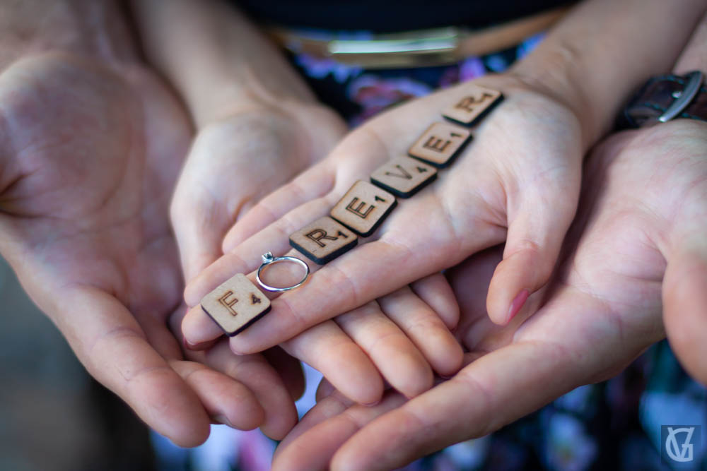 couple holding scrabble letters