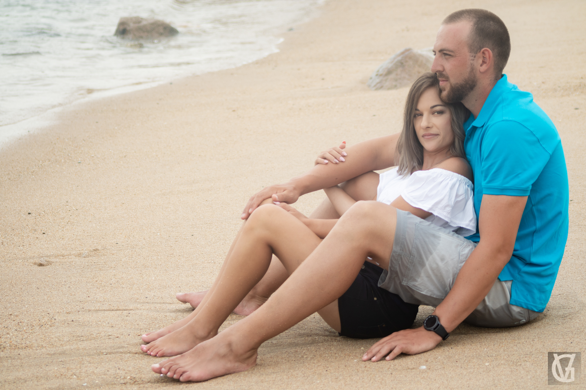 A couple sitting together on a beach near Margate, KZN