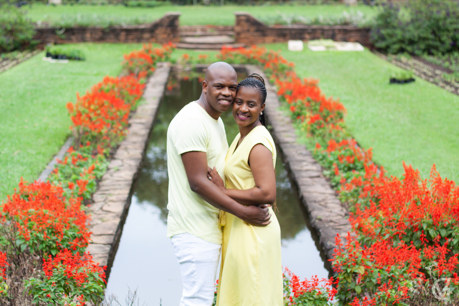 A couple in the Durban Botanic Gardens surrounded by red flowers