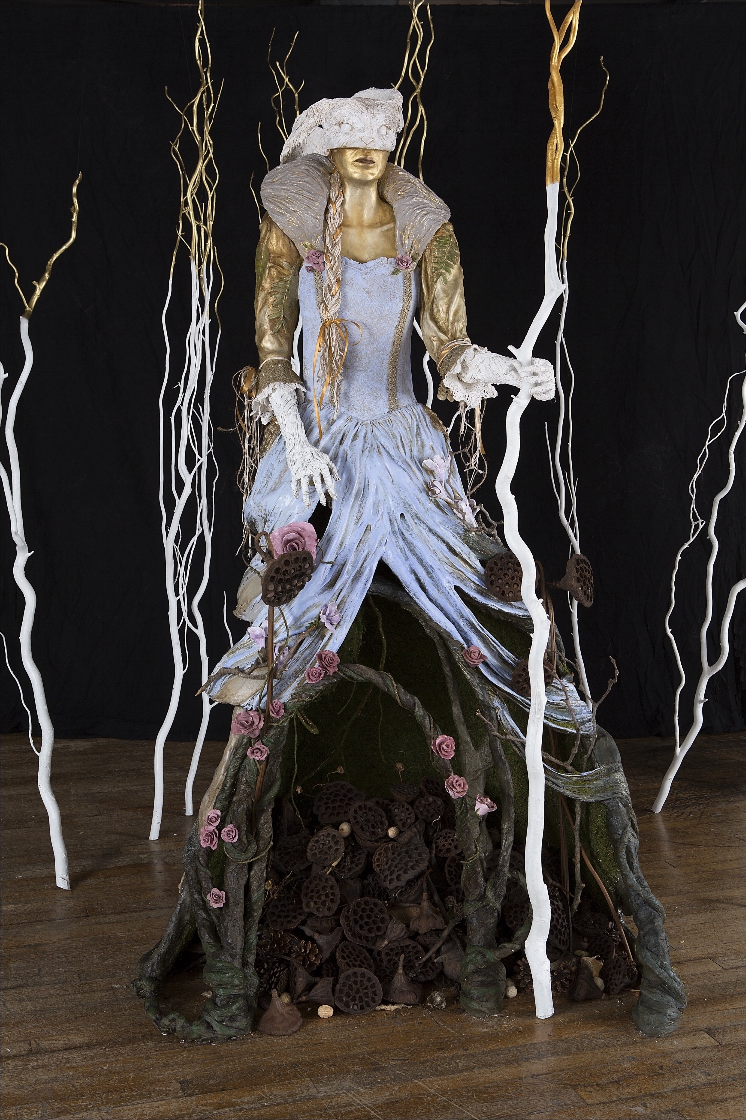 Forest Muse - Relentlessly determined to reverse what man has done, The gilded Forest Muse carpets the floor with seeds for regrowth.Steel, paperclay, found objects.This is an installation which includes her gilded branches. It can be adjusted to fit any space. Her personal footprint is approximately 7'T x 4'W x 3'D. Branches will expand beyond that.Not for sale*photo by Don Rosser