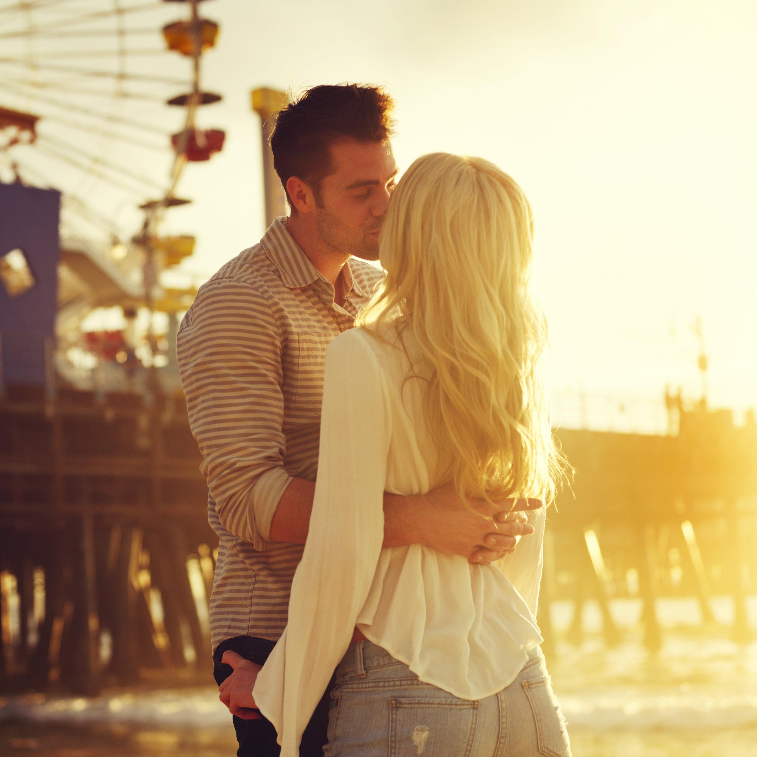 couple kissing at the fair.jpeg