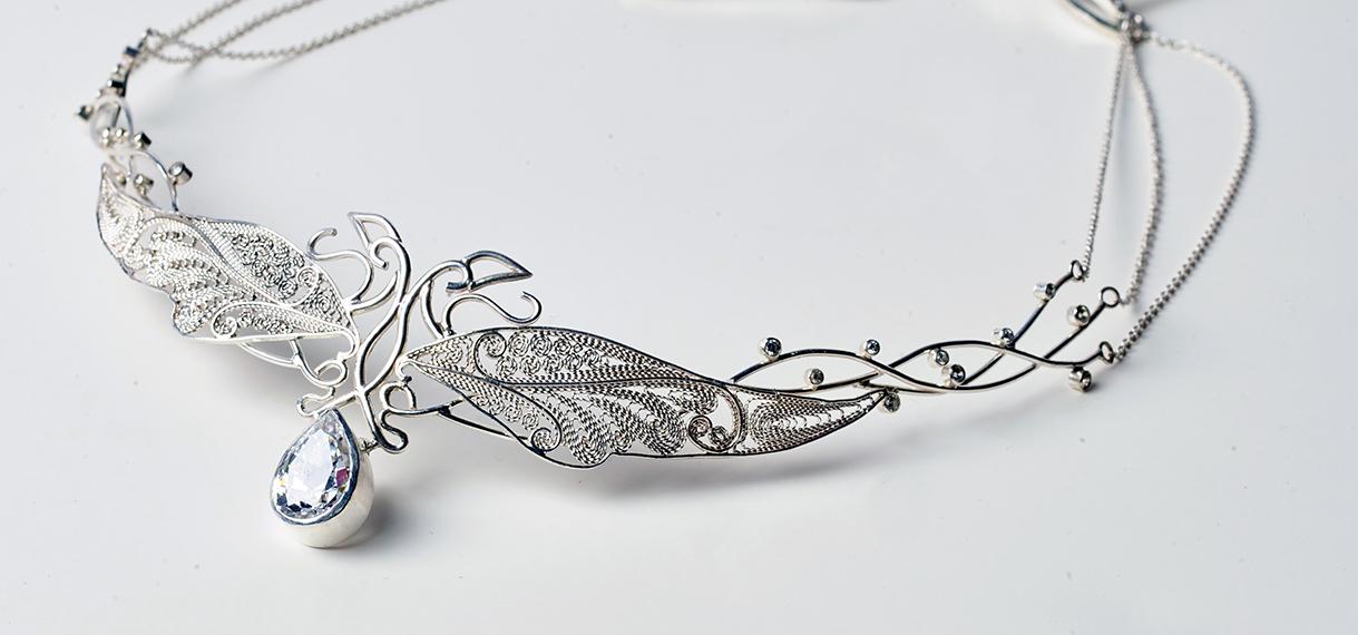 Samantha Tran  Phoenix Coronet  (2019) Fine silver, Swarovski crystal Image by Kevin Yue
