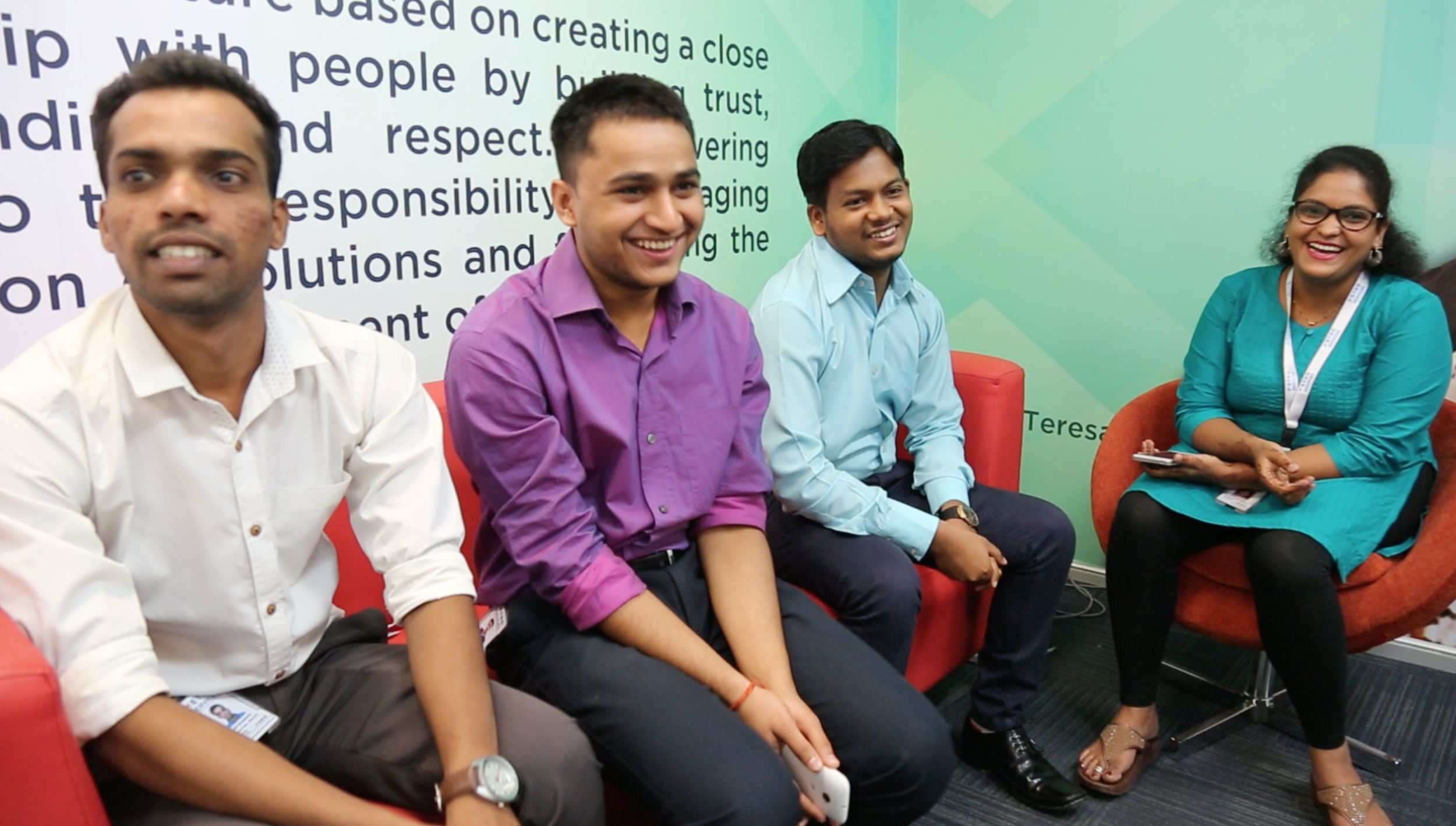 Akshay (second from right) and fellow Lighthouse Graduates in their office at Metro Global Services