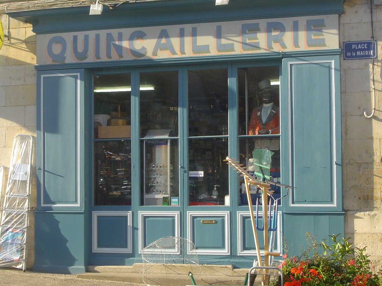 Restoration of 19th century shop-front using linseed paint. Quincaillerie Mallet, Mirambeau, FRANCE.