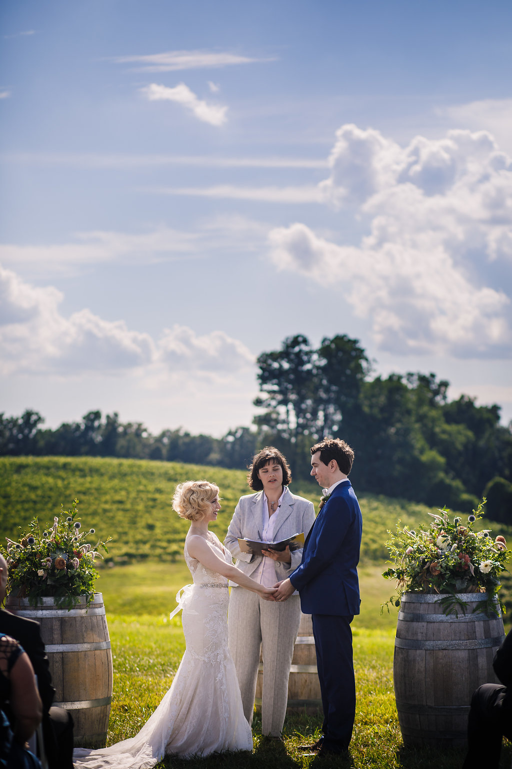brielle-davis-events-photography-by-brea-linganore-winery-james-sarah-wedding-ceremony-bride-and-groom-at-alter.jpg