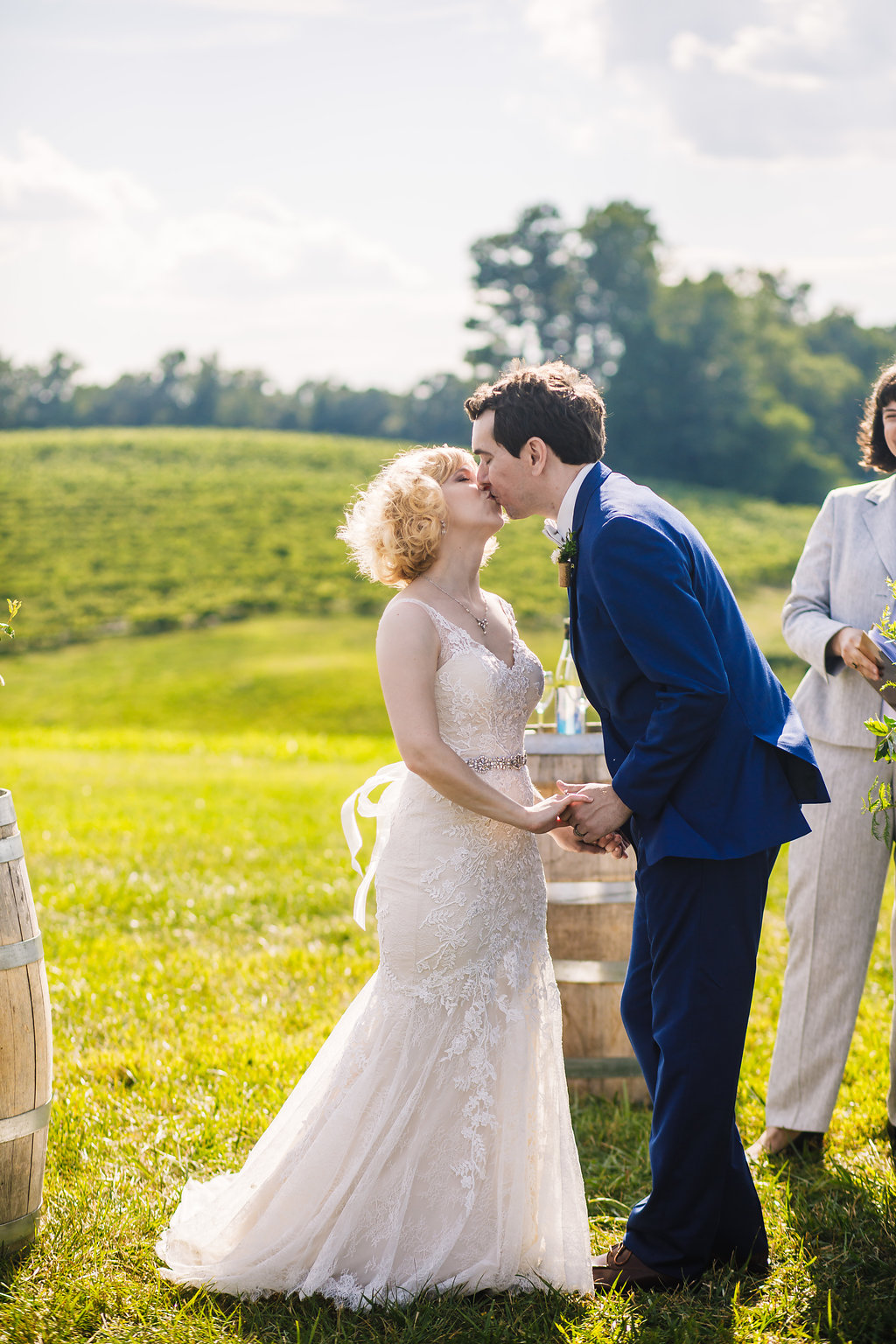 brielle-davis-events-photography-by-brea-linganore-winery-james-sarah-wedding-ceremony-first-kiss.jpg
