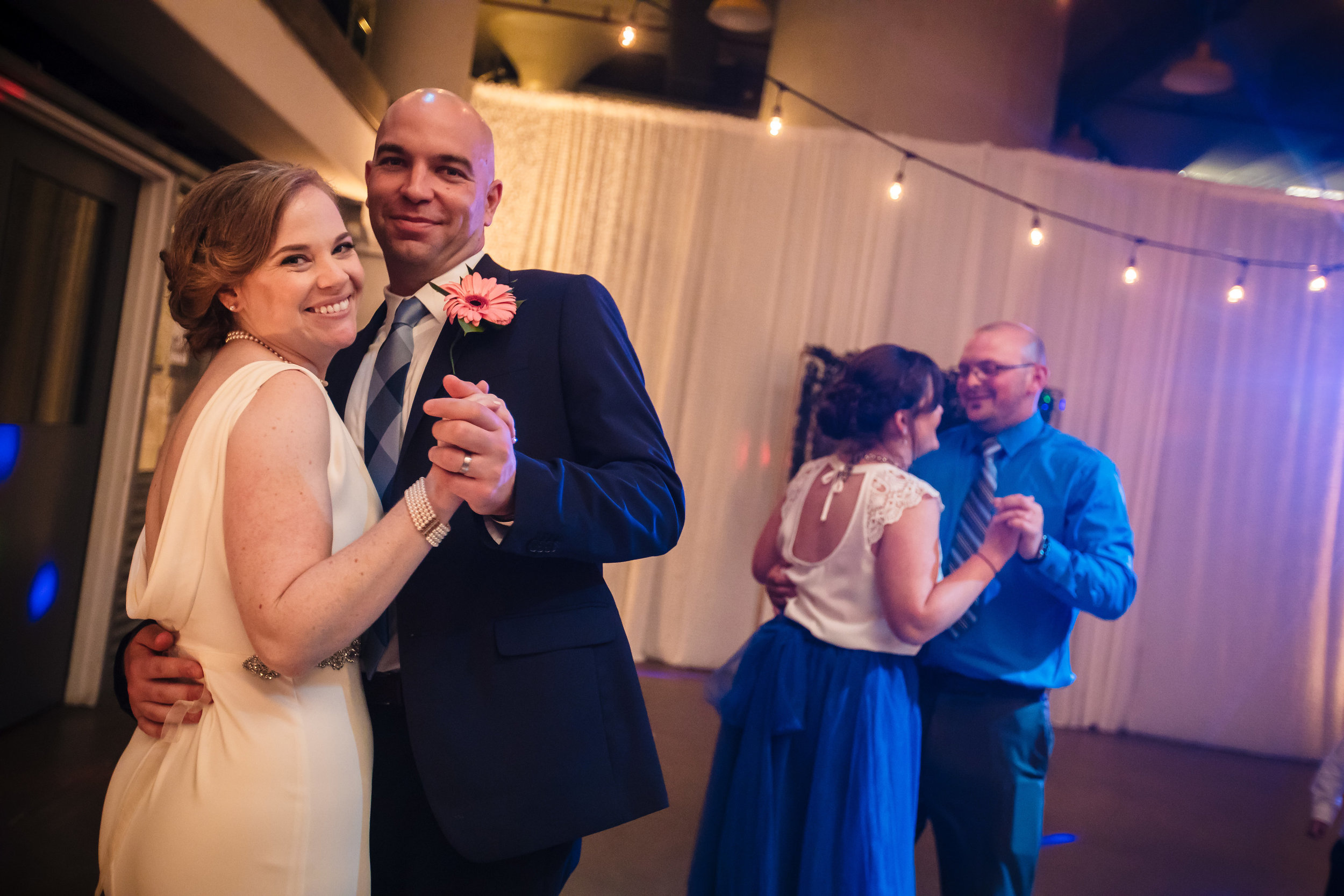 brielle-davis-events-torpedo-factory-wedding-reception-bride-and-groom-dancing-photography-by-brea.jpg