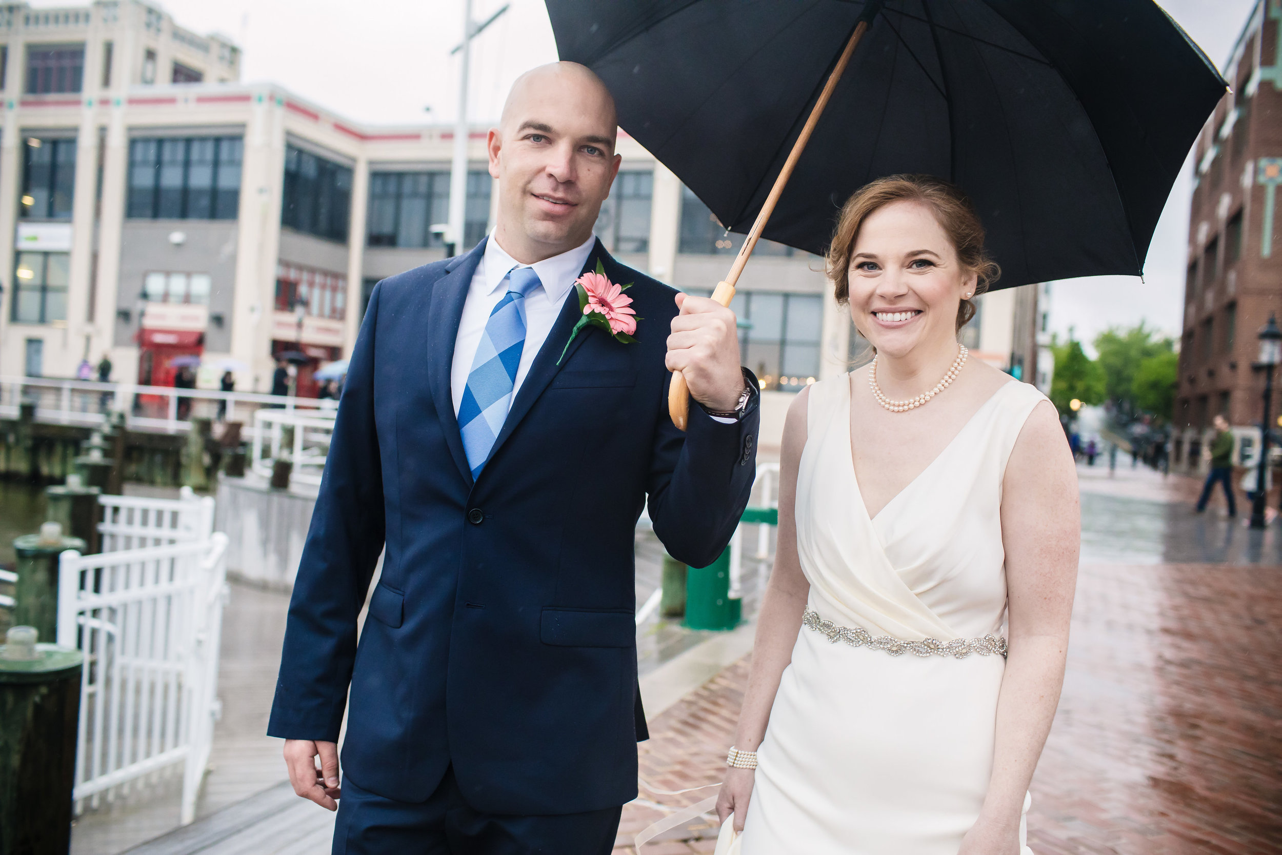 brielle-davis-events-torped-factory-wedding-bride-and-groom-outside-umbrella-raining-photography-by-brea.jpg