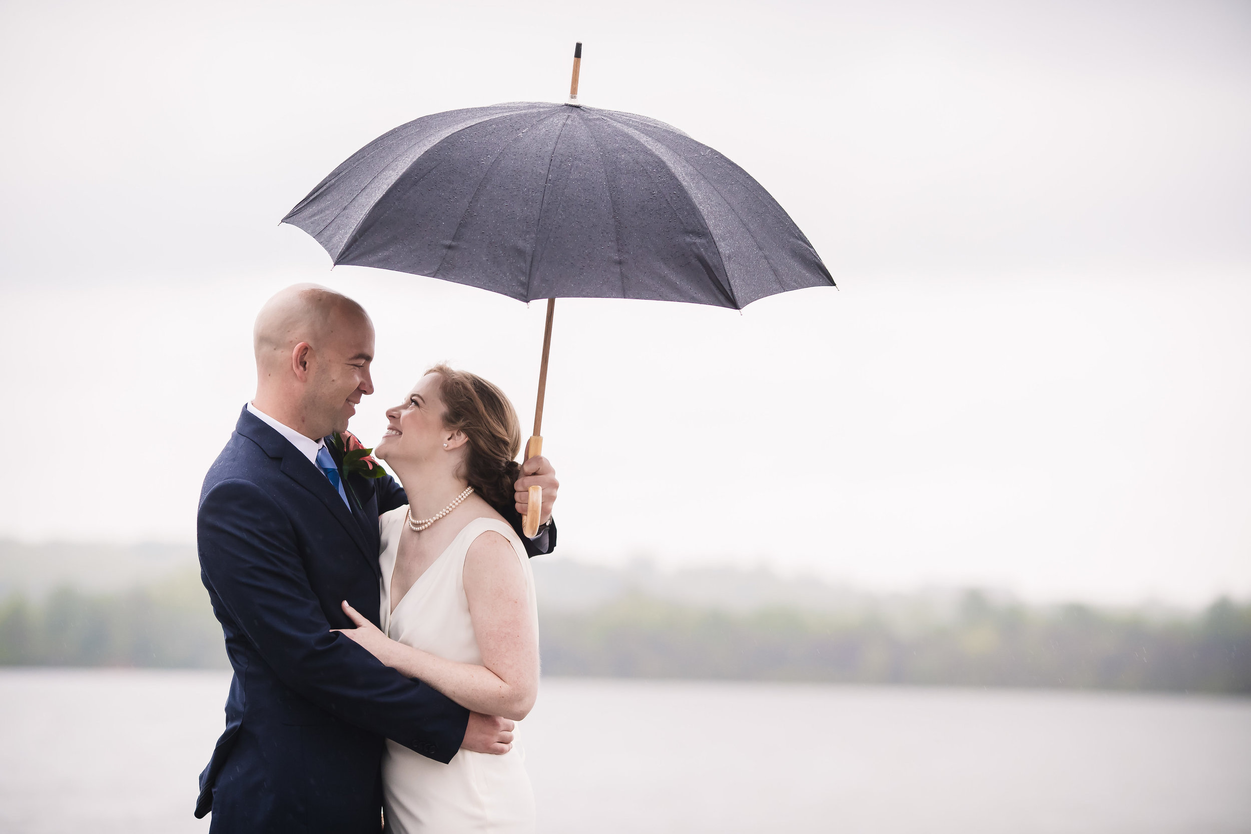 brielle-davis-events-torpedo-factory-wedding-bride-and-groom-rain-photography-by-brea.jpg
