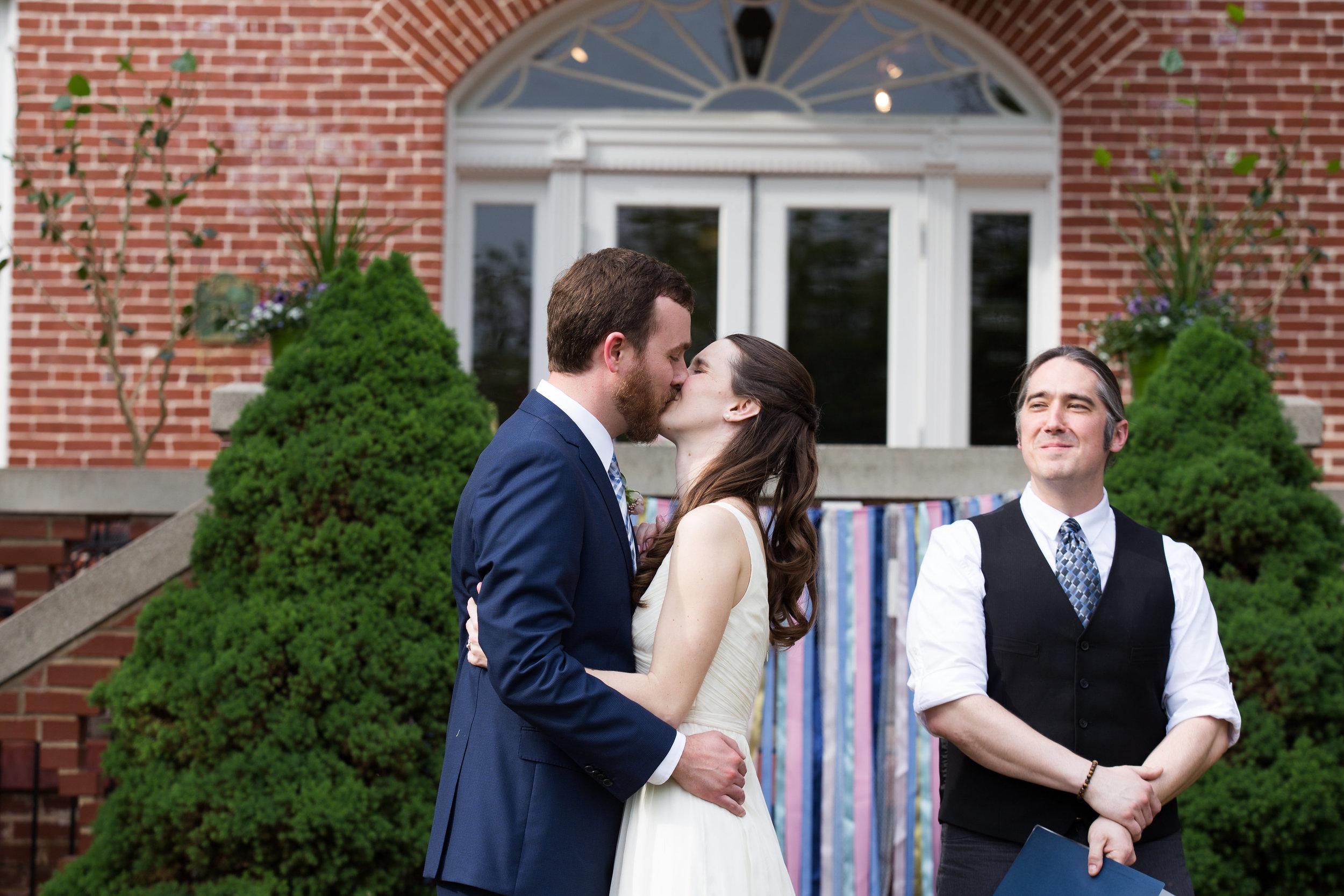 julie-dicarlo-photography-kentlands-mansion-wedding-brielle-davis-events-wedding-ceremony-kiss.jpg
