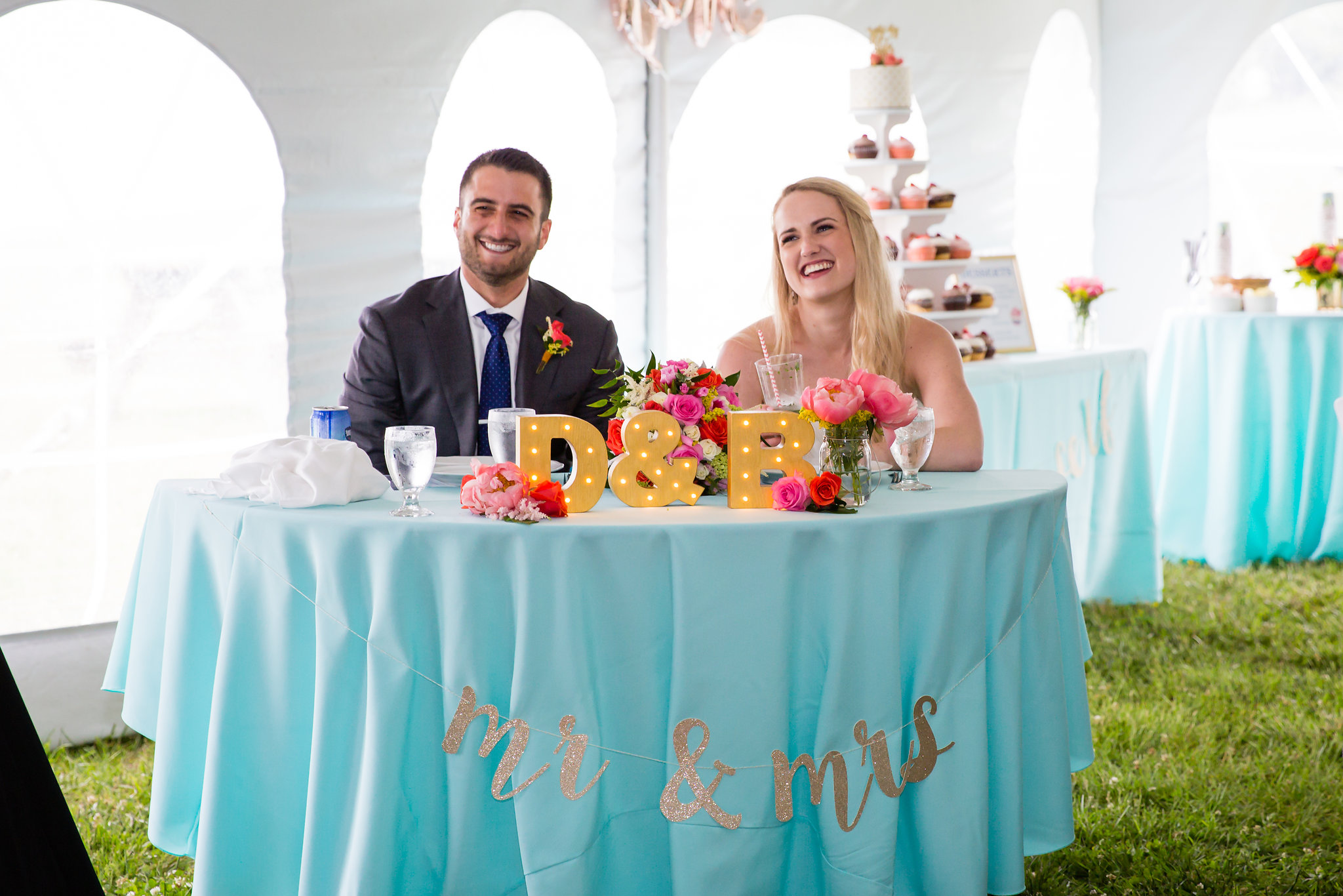 brielle-davis-events-weatherly-farm-waterfront-wedding-reception-bride-and-groom-enjoying-toasts.jpg