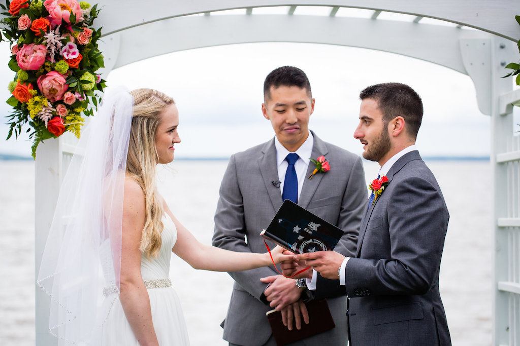 brielle-davis-events-weatherly-farm-waterfront-wedding-ceremony-groom-reading-vows.jpg