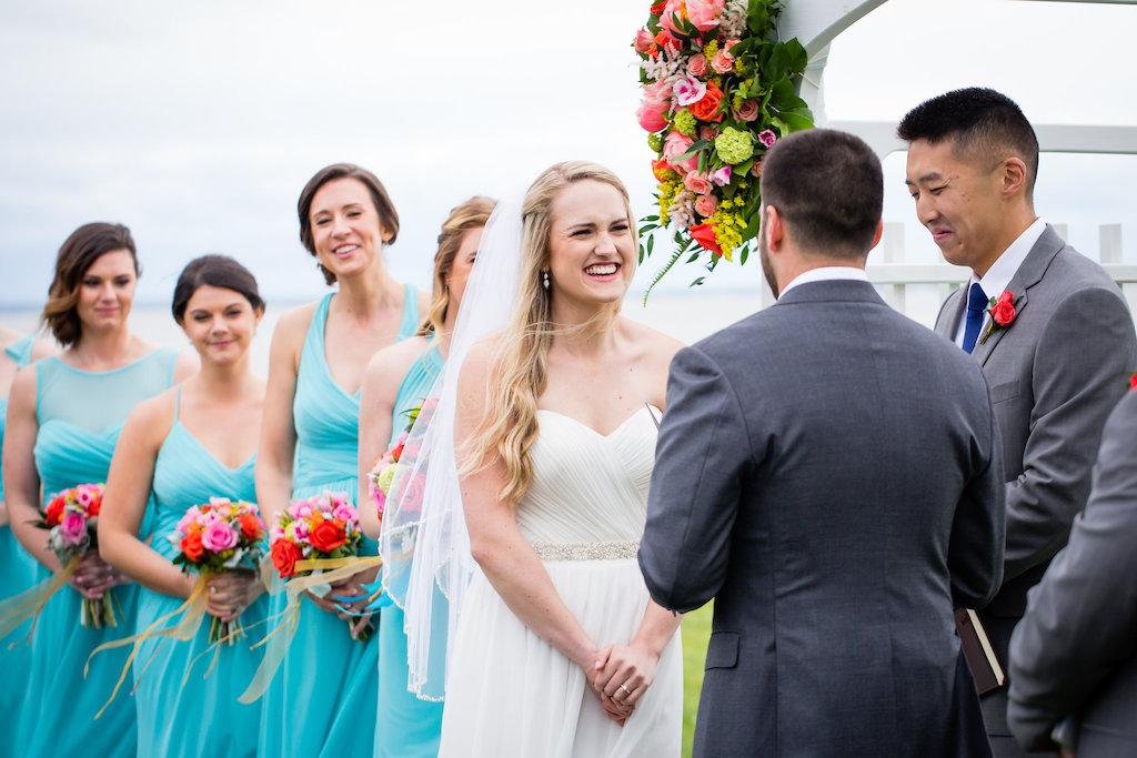 brielle-davis-events-weatherly-farm-waterfront-wedding-ceremony-bride-listening-to-vows.jpg
