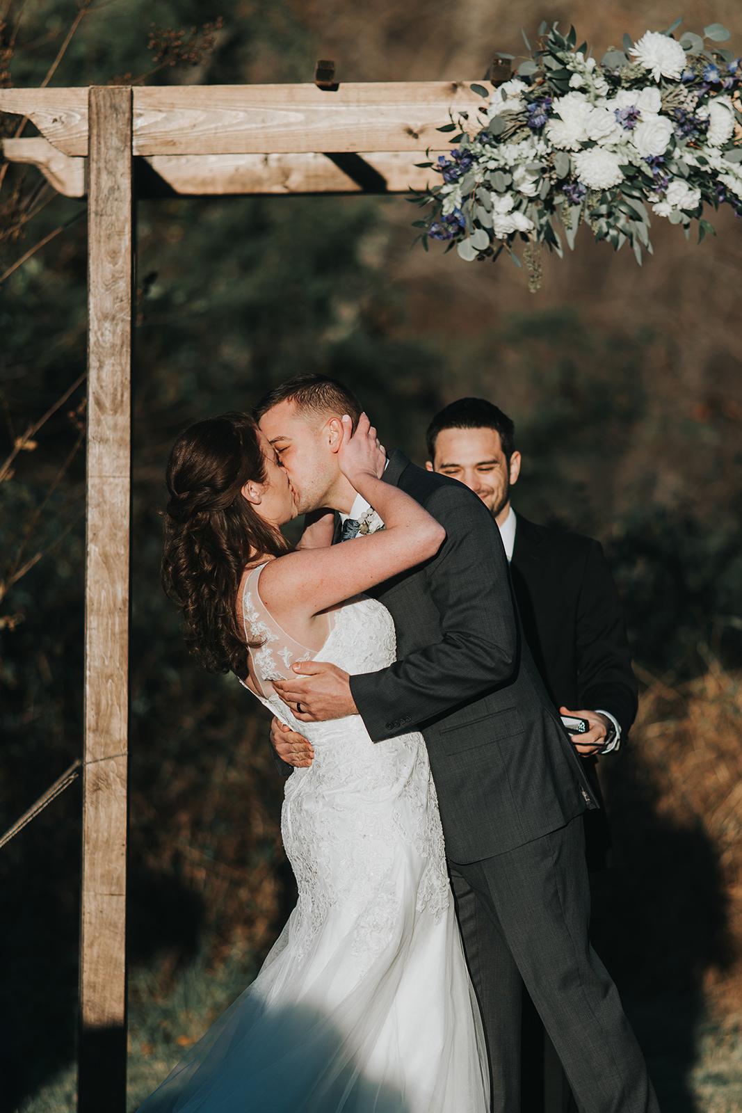 brielle-davis-events-48-fields-wedding-ceremony-kiss.jpg