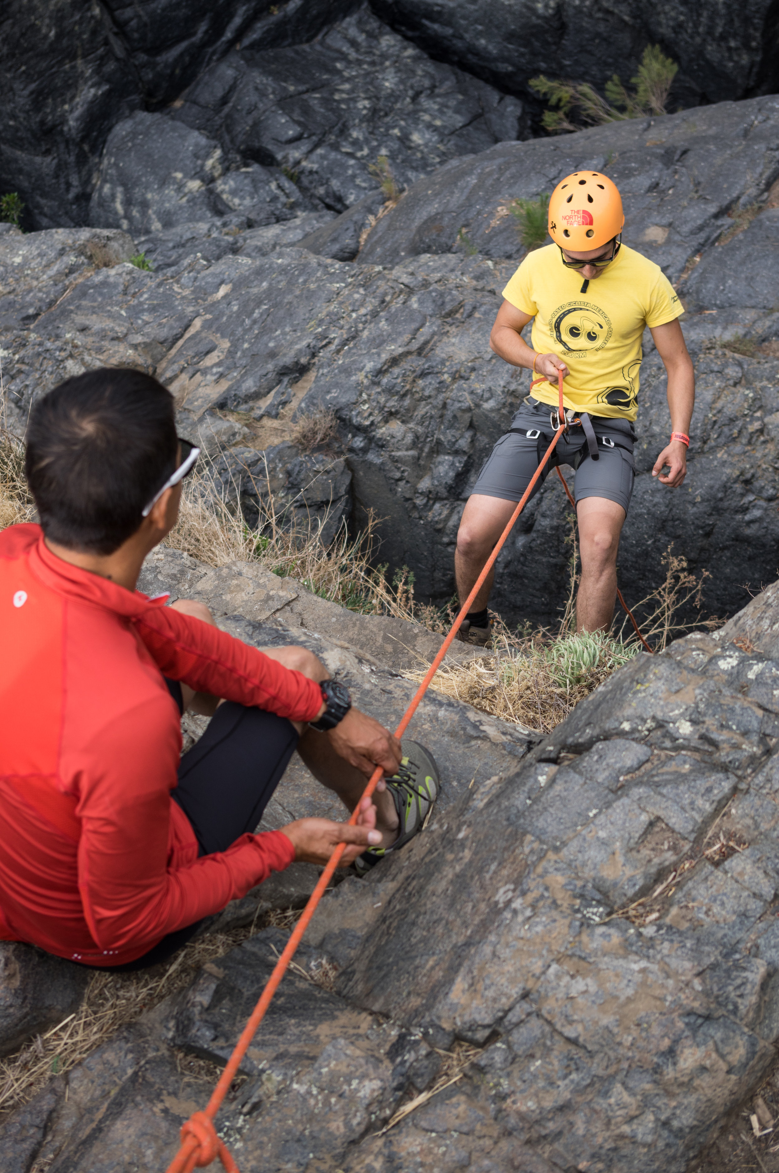 Sebastian (right) begins his first descent down a 15 meter wall.