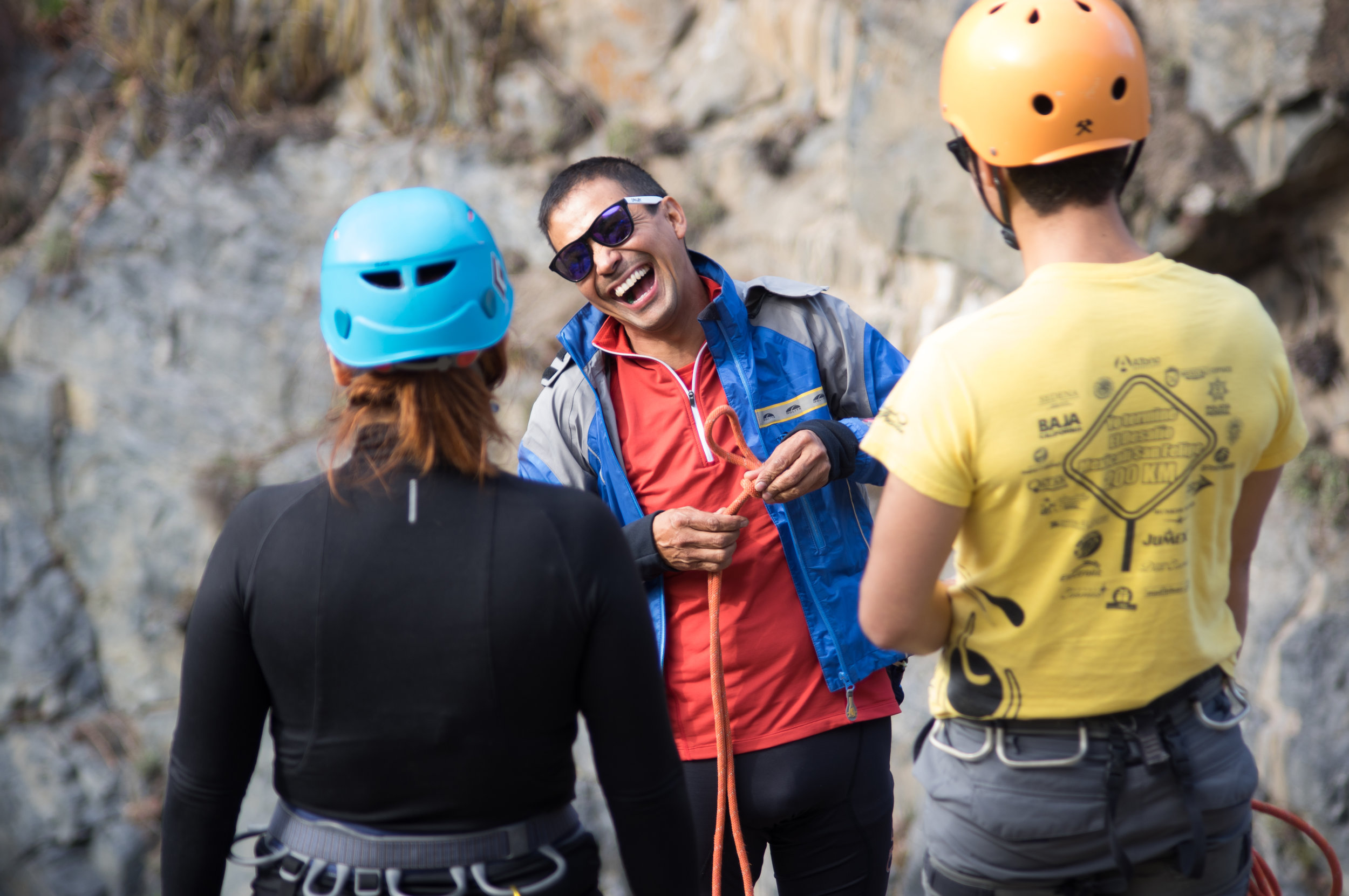 Archie [center] resembles every outdoor magazine poster child ever. Tanned and wiry from years outdoors, he sports an ocean blue windbreaker, Patagonia pants, and a blinding smile.