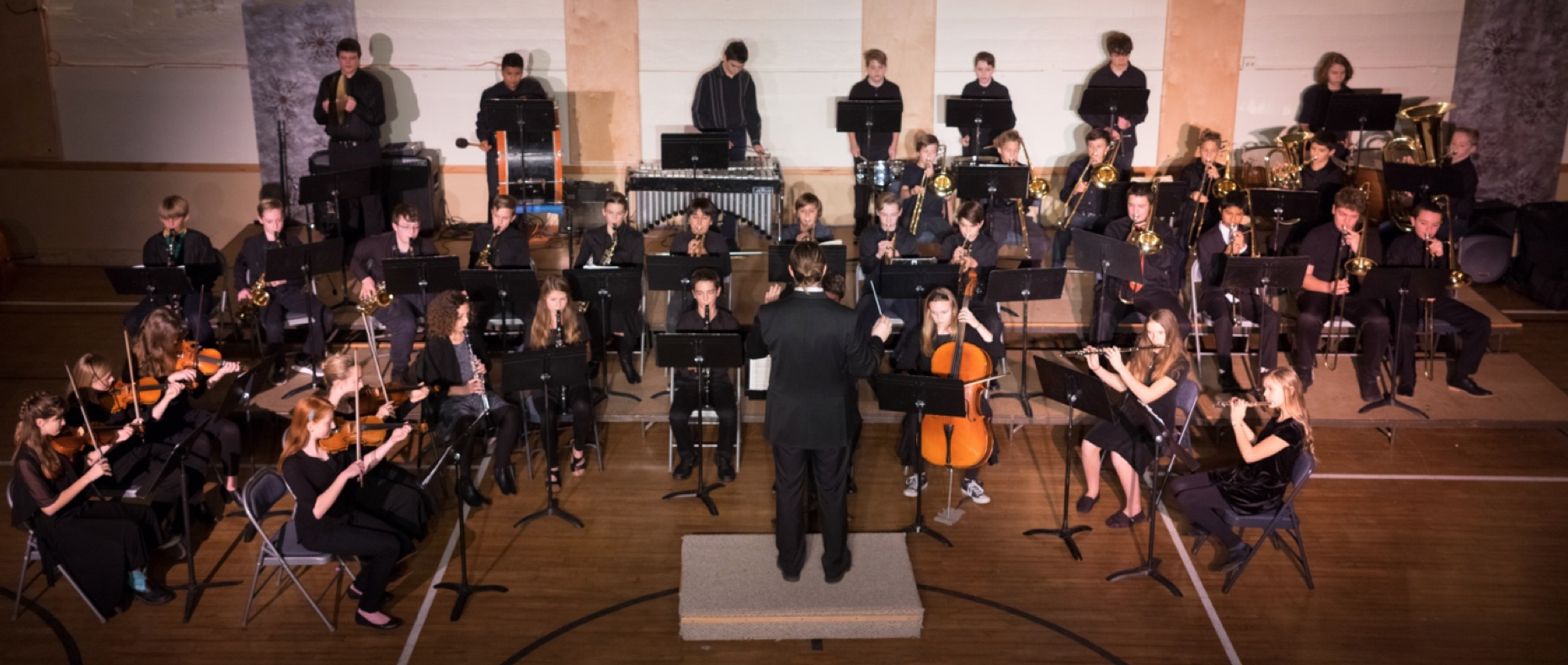 Conductor Matthew Ambrose conducts the 7th-12th graders of Liberty Bell concert band in the piece Dance Macabre.