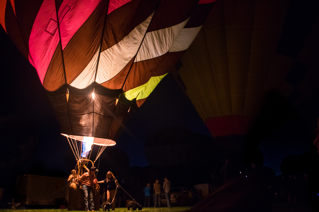 David uses a second smaller balloon to participate in the festival's nightly Twinkle Twinkle Glow event where the hundreds of balloons remain stationary but ignite their burners to create an immense sparkling effect.