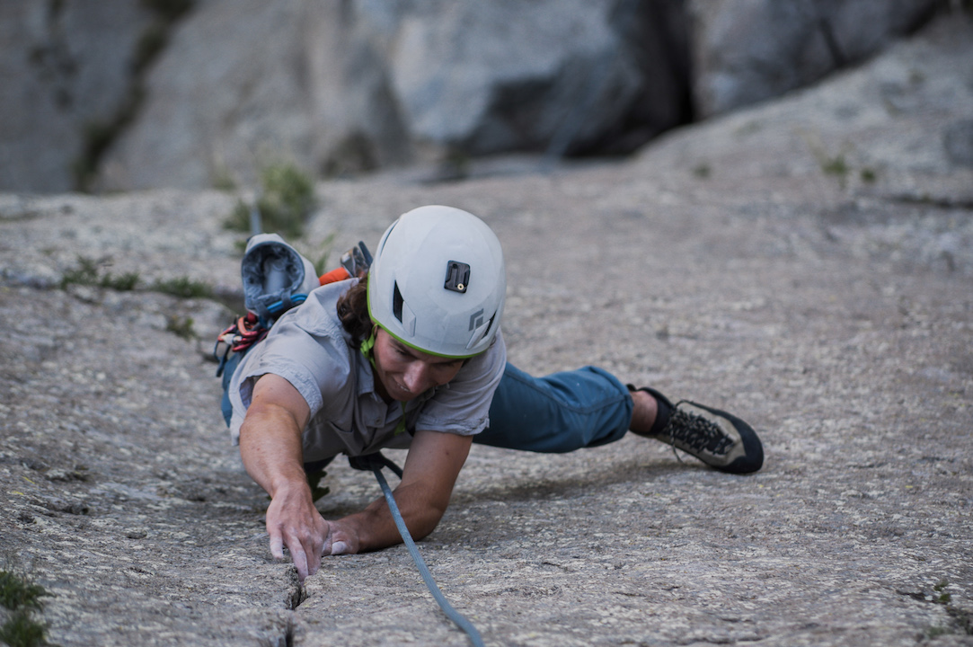 """Austin Rust from North Dakota cranks up the first pitch of """"One Way Sunset"""" (5.10C). Shooting up the Northwest face of Devils Tower, the crack provides one of the best finger cracks in Eastern Wyoming."""