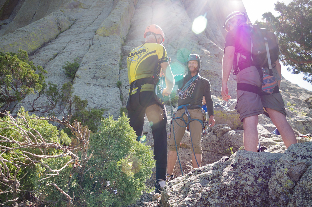 Rostyn Hamilton (center) instructs two clients on proper crack climbing technique. The Lodge operates as half bed and breakfast and half climbing guide service. The three summited the day after via the Durrance Crack. (5.7)
