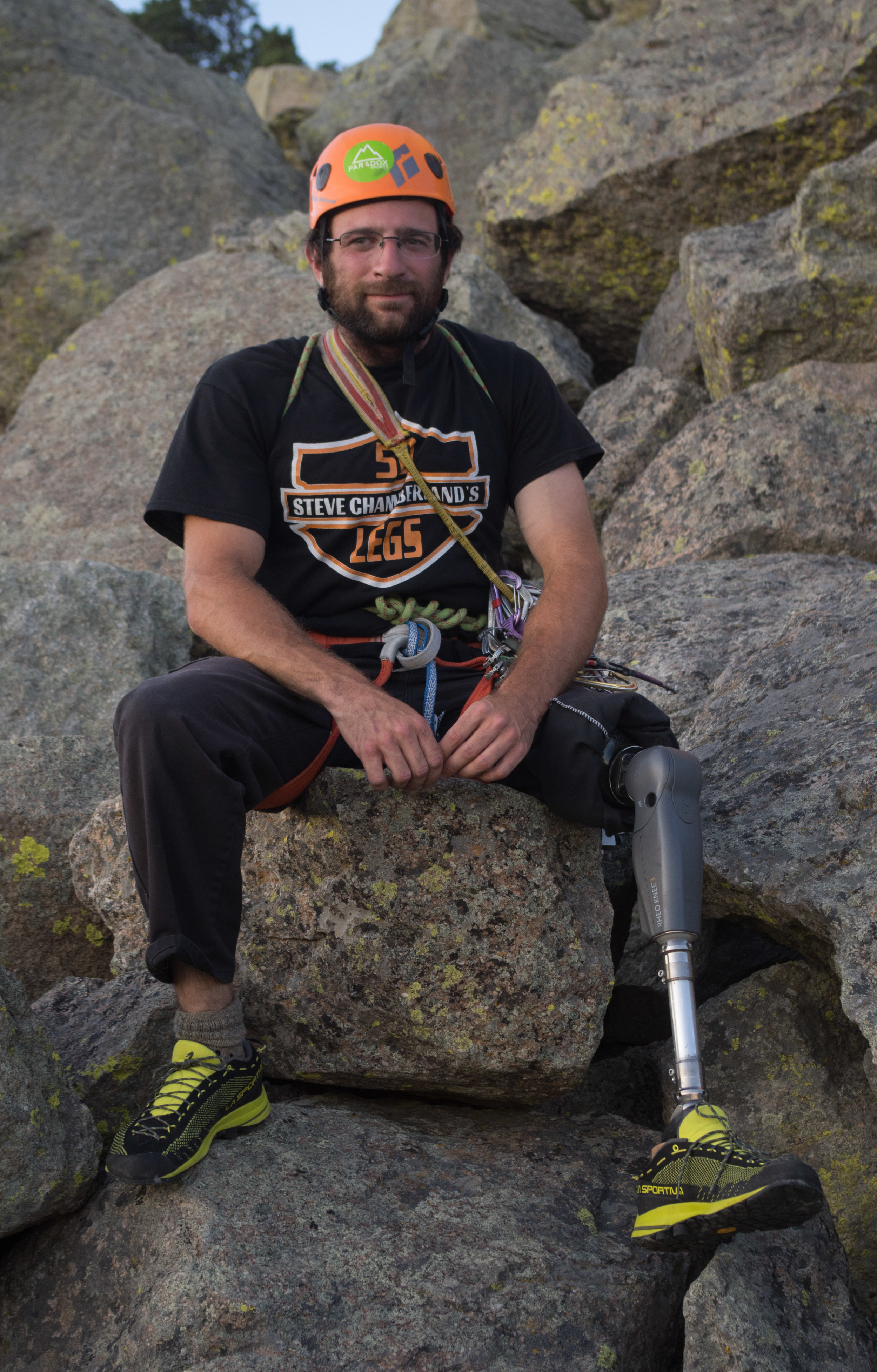 Dave poses for a portrait on the boulder field of Devils Tower. He spent a month at the Lodge summiting multiple times and climbing dozens of routes.