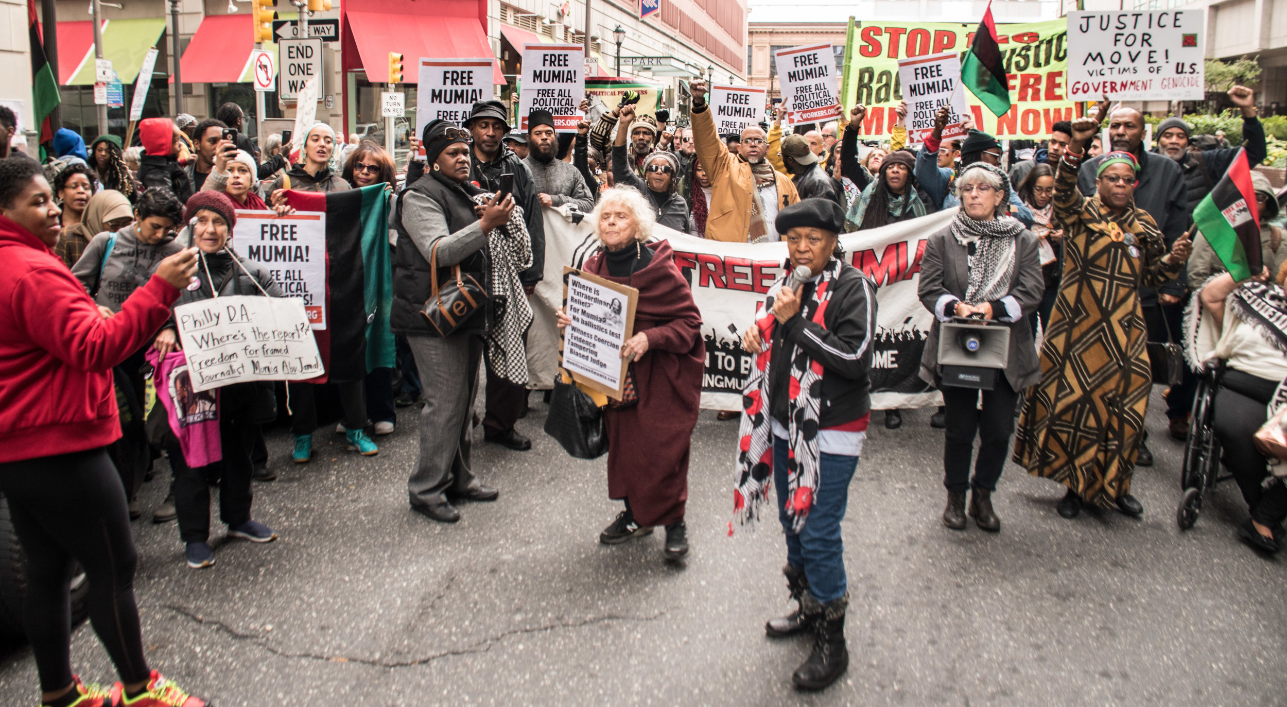 Mumia supporters take the street following a Oct 29, 2018 court hearing.