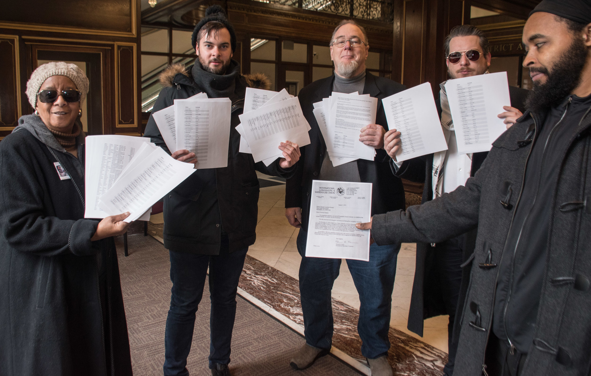 Jan 7, 2019 Thousands of Mumia Abu-Jamal Petitions delivered to DA Krasner  L to R: Linda Ragin, Scott Williams, John Kirkland, Ted Kelly, Wayne Cook