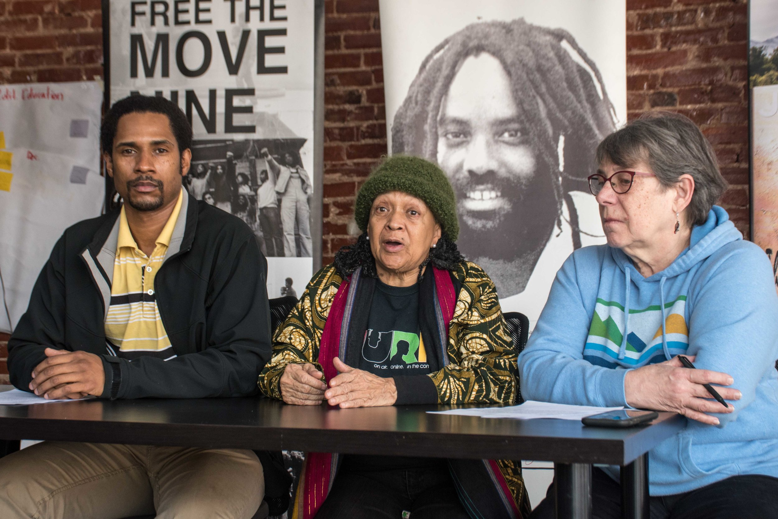 2.2.19 Philadelphia - Press Conference describes the significance of the Feb 1 dis-invitation of Philadelphia District Attorney Larry Krasner by the Rebellious Lawyering (RebLaw) conference at Yale University. Video to be posted soon.  L to R: Mike Africa Jr (MOVE Organization), Pam Africa (International Concerned Family and Friends of Mumia Abu-Jamal), Betsey Piette (Mobilization4Mumia)