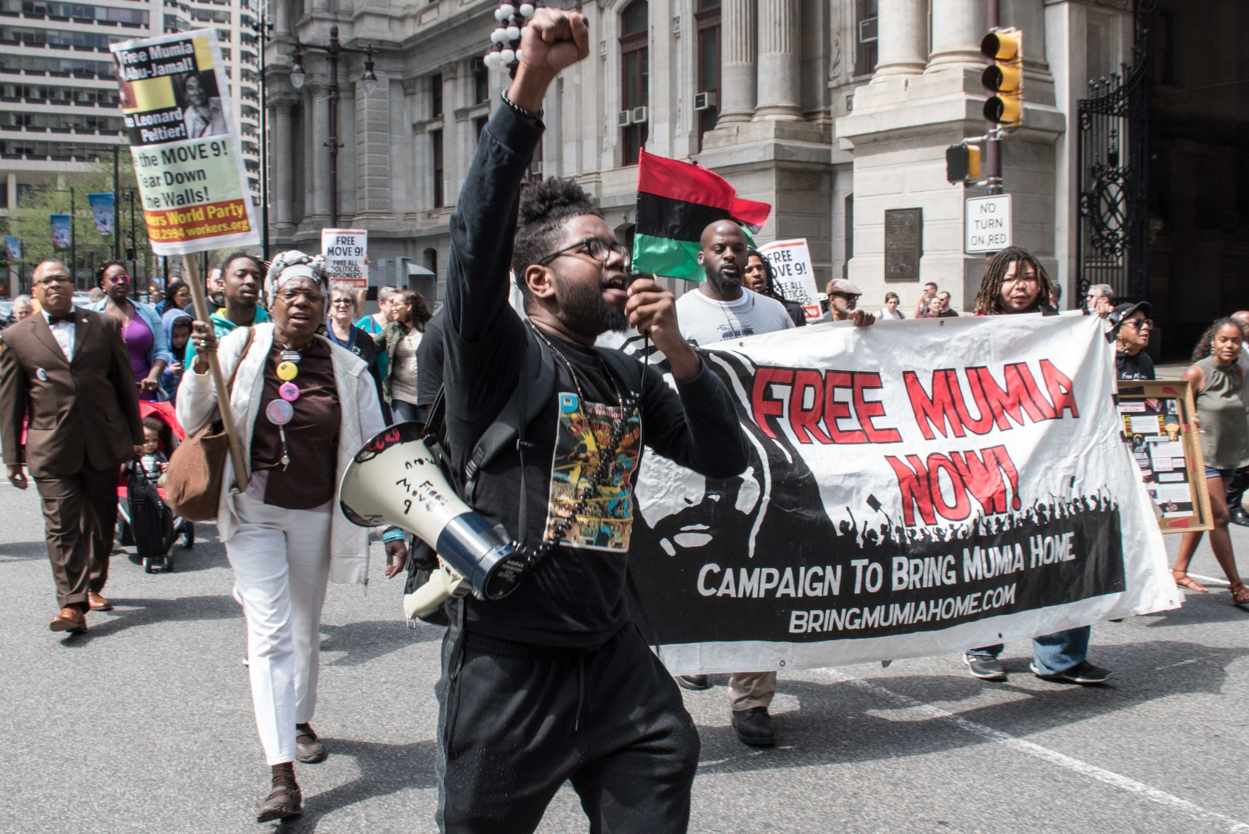 Philadelphia, Apr 18, 2019 - Press Conference for Mumia Abu-Jamal. REAL Justice member Ant Smith leading march from Octavius Catto statue at City Hall to District Attorneys office. (photo credit: Joe Piette)