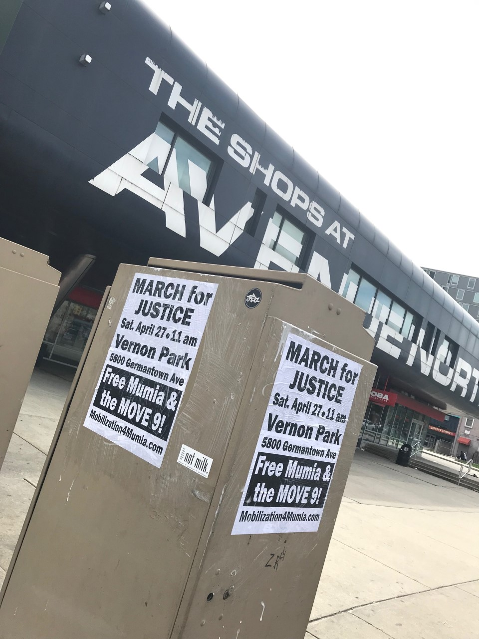 Posters at N. Broad and Cecil B Moore advertising April 27 March for Justice for Mumia