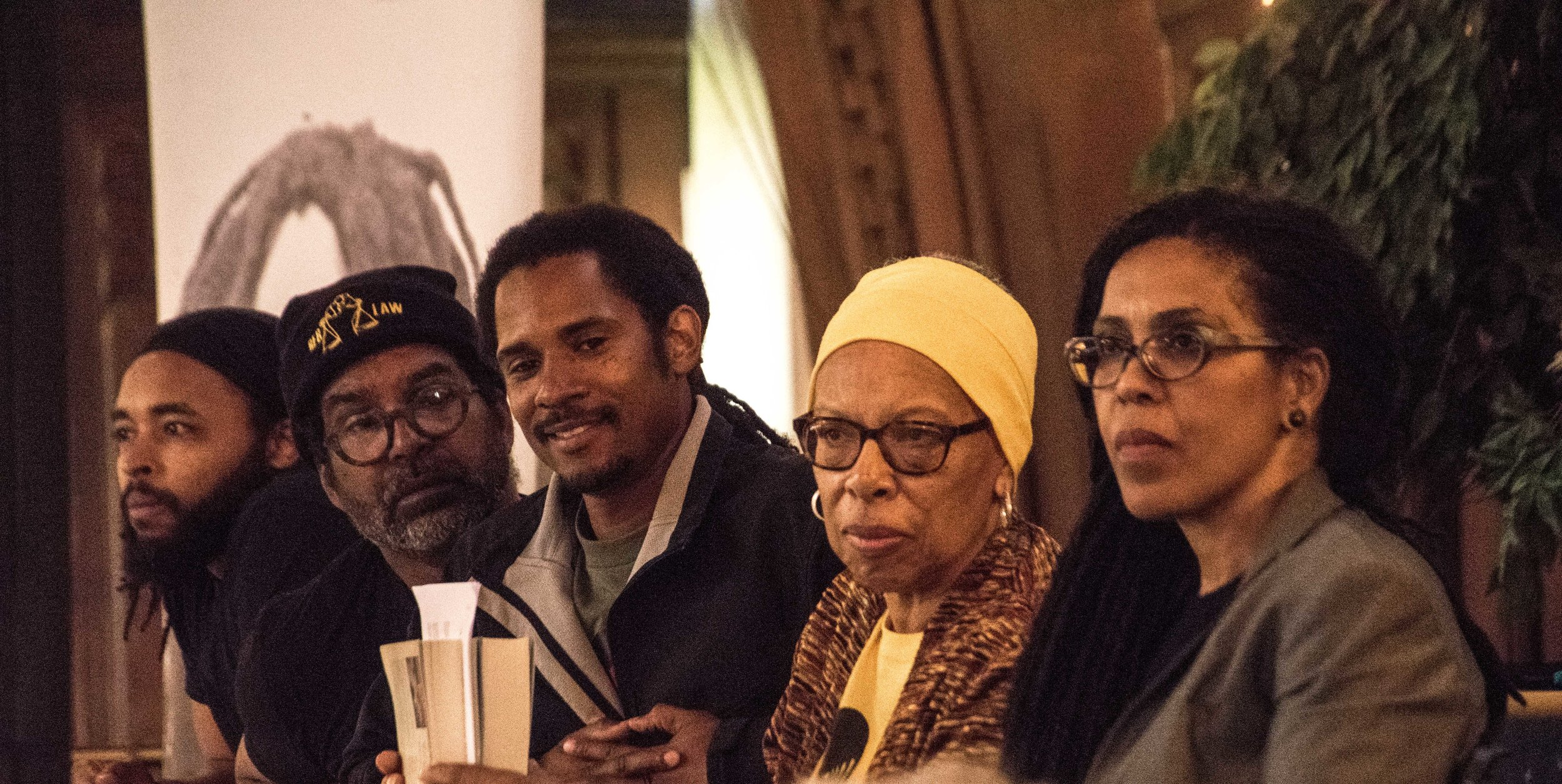 The panelists who read parts of Mumia's new book, Murder Inc, Vol 2, at People's Sanctuary April 27. (L to R) Wayne Cook, Basym Hasan, Mike Africa Jr, Barbara Easley-Cox, Johanna Fernandez  Photo credit - Joe Piette