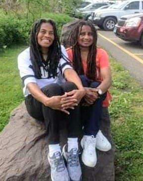 Janet Africa (L) and Janine Africa (R) after being released from prison.