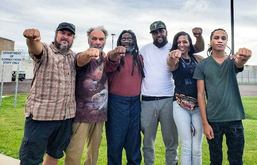 Photo includes from far left: Fred Riley, Carlos Africa, Eddie in the middle, his son Little Eddie, daughter in law Sukona, and Raymond Africa jr Photo courtesy of MOVE