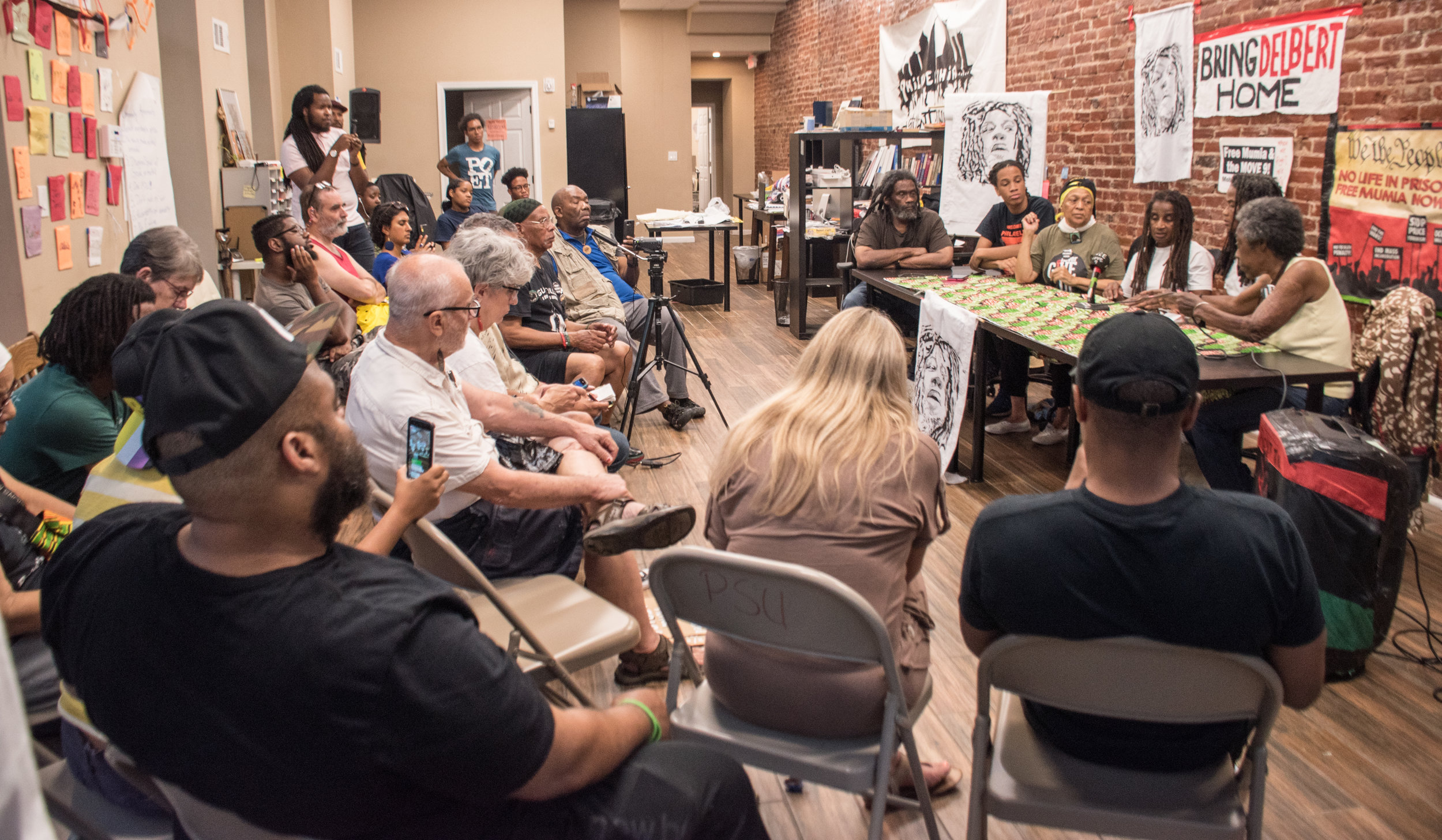 Philadelphia Press Conference Aug 7 warns crowd PA DOC is attempting to kill MOVE 9 unfairly convicted prisoner Delbert Africa. Photo credit: Joe Piette