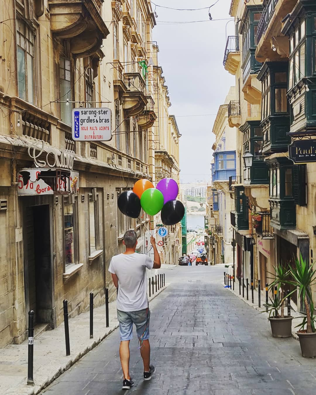 Director Ivan Malekin leads the way in Valletta. Off to our technical rehearsal after collecting our prop balloons early Sunday morning.