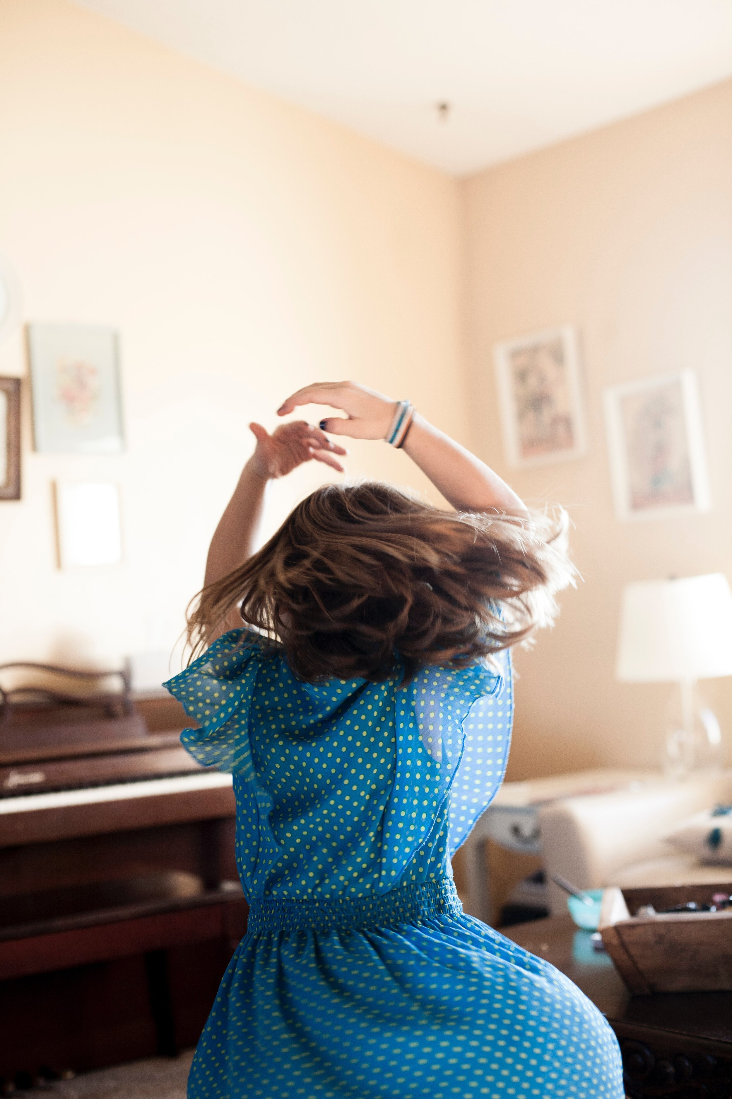 """Photo by  Laura Fuhrman  on  Unsplash  """"It was a normal Saturday morning at our house, and I pulled out my camera to document the happenings of our morning. My middle daughter put on some music and started dancing. The morning sun was shining through the windows beautifully as I caught her in mid twirl."""""""