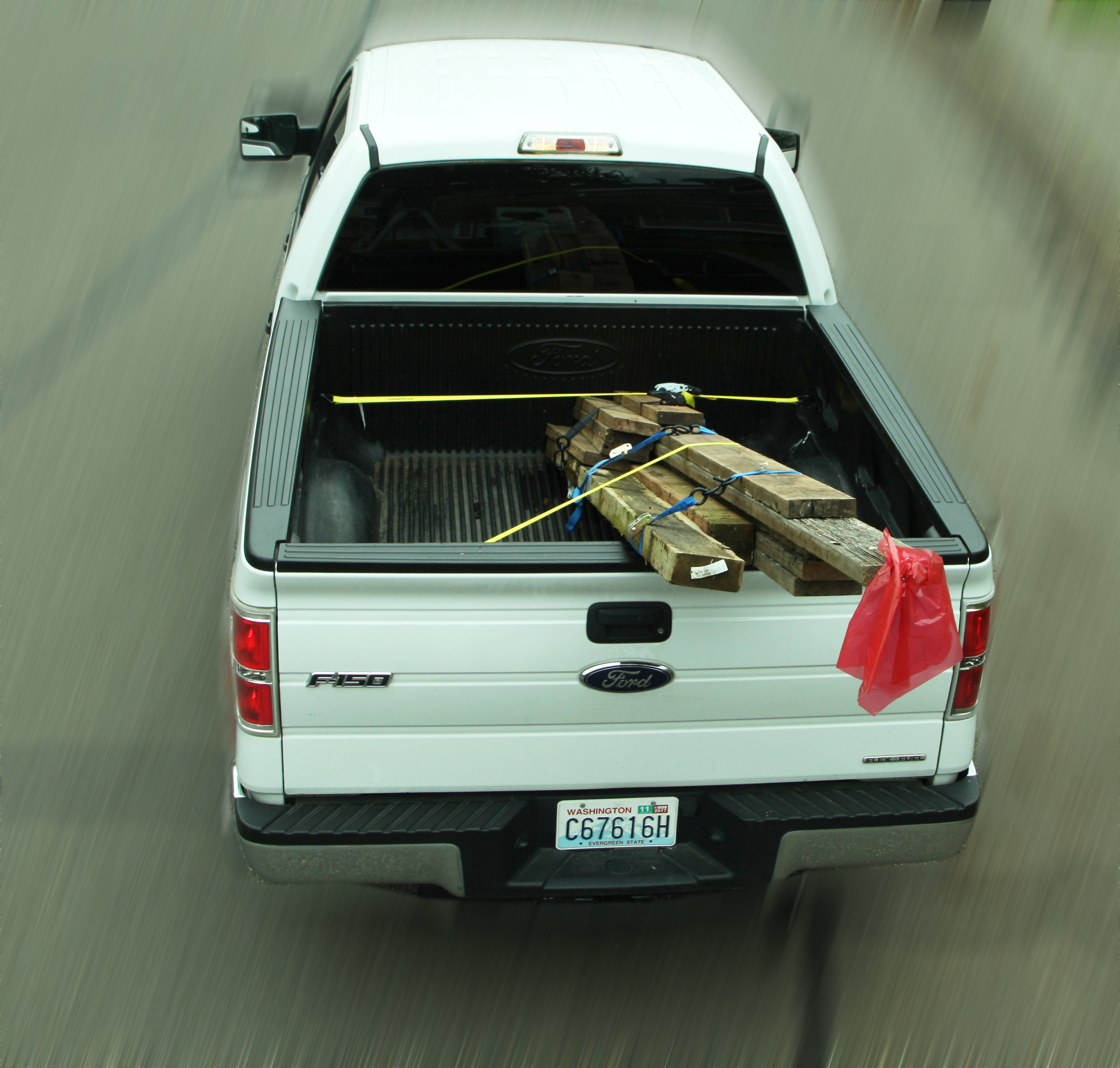 All corners of a load should be tagged with red flags (one foot by one foot), if the load extends four feet beyond the bed of a truck or trailer